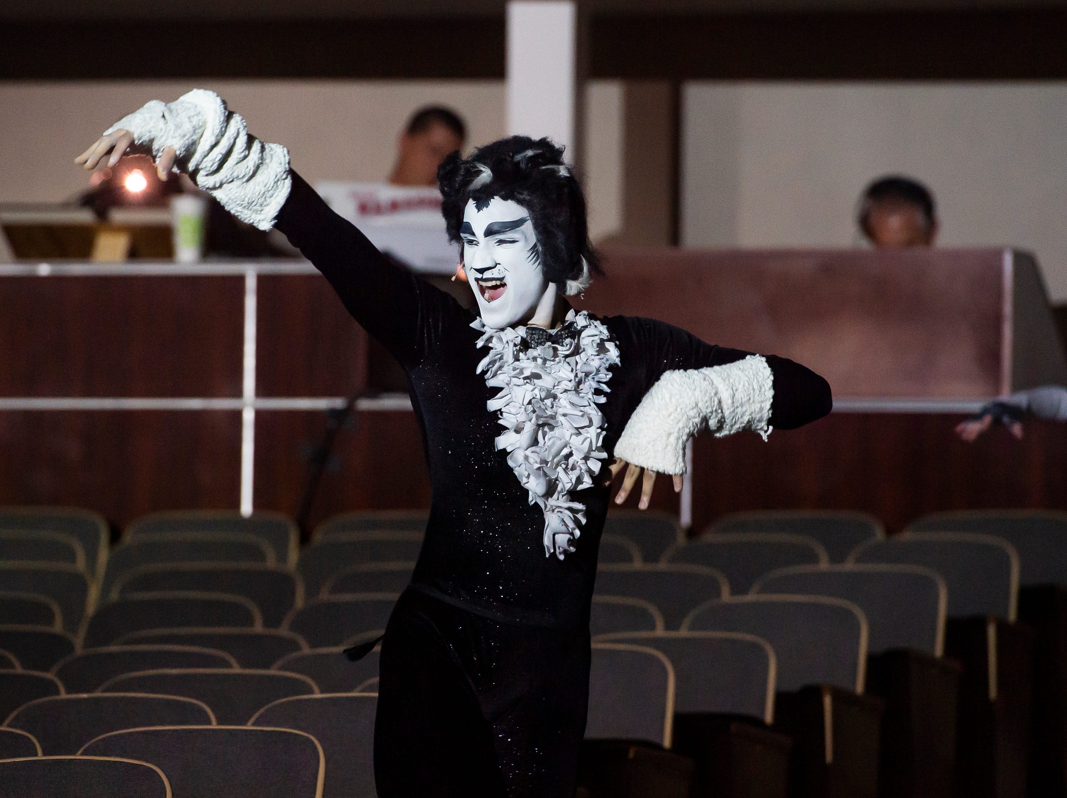"""Malcolm Ellis makes an entrance during a dress rehearsal for the Hanover High School production of the musical """"Cats"""" on Wednesday, April 10, 2019. Ellis performs the role of principle character Mr. Mistoffelees."""