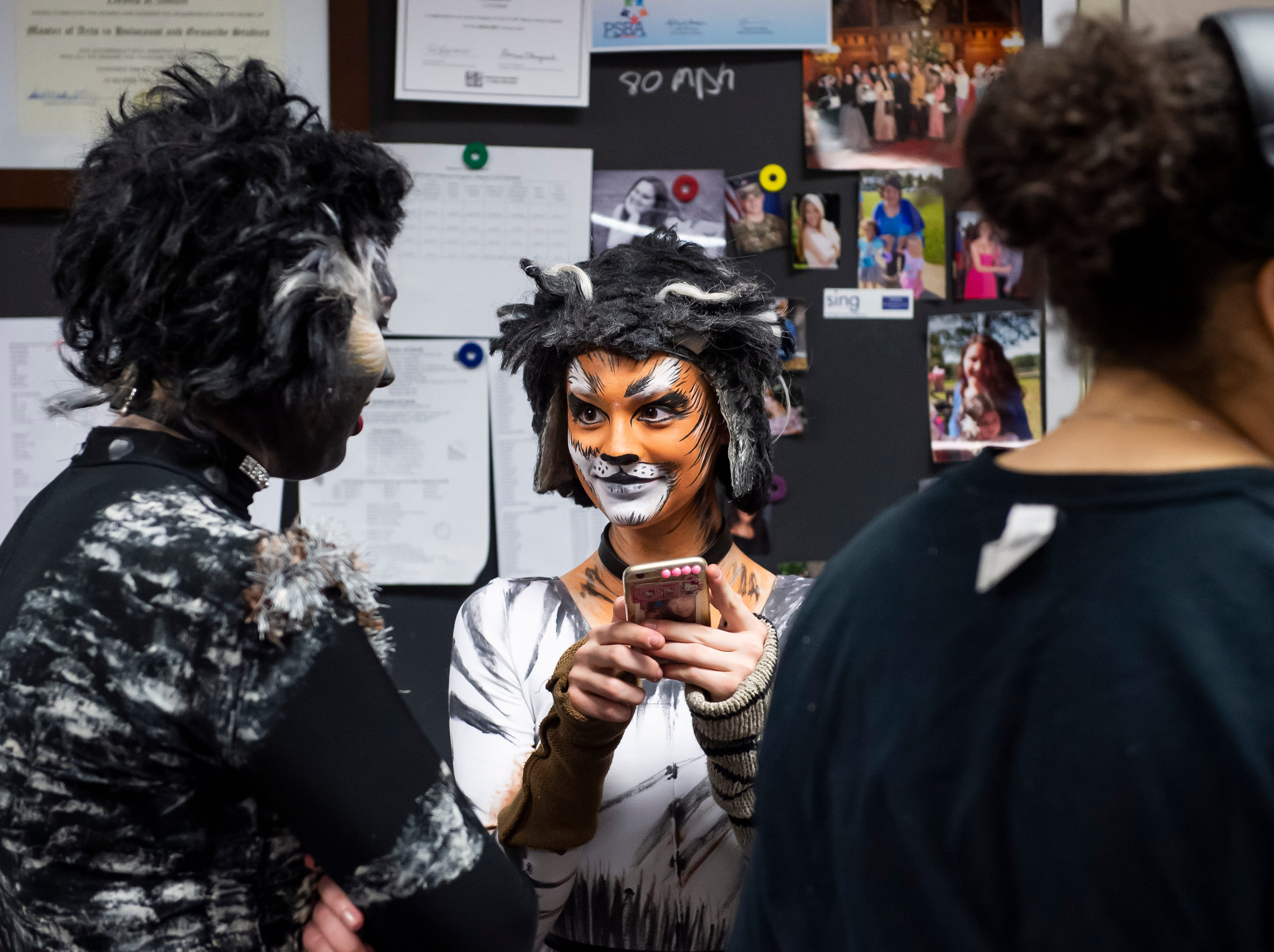 """Hanover High School students wait for the start of the second act to begin at dress rehearsal for their production of the musical """"Cats"""" on Wednesday, April 10, 2019."""