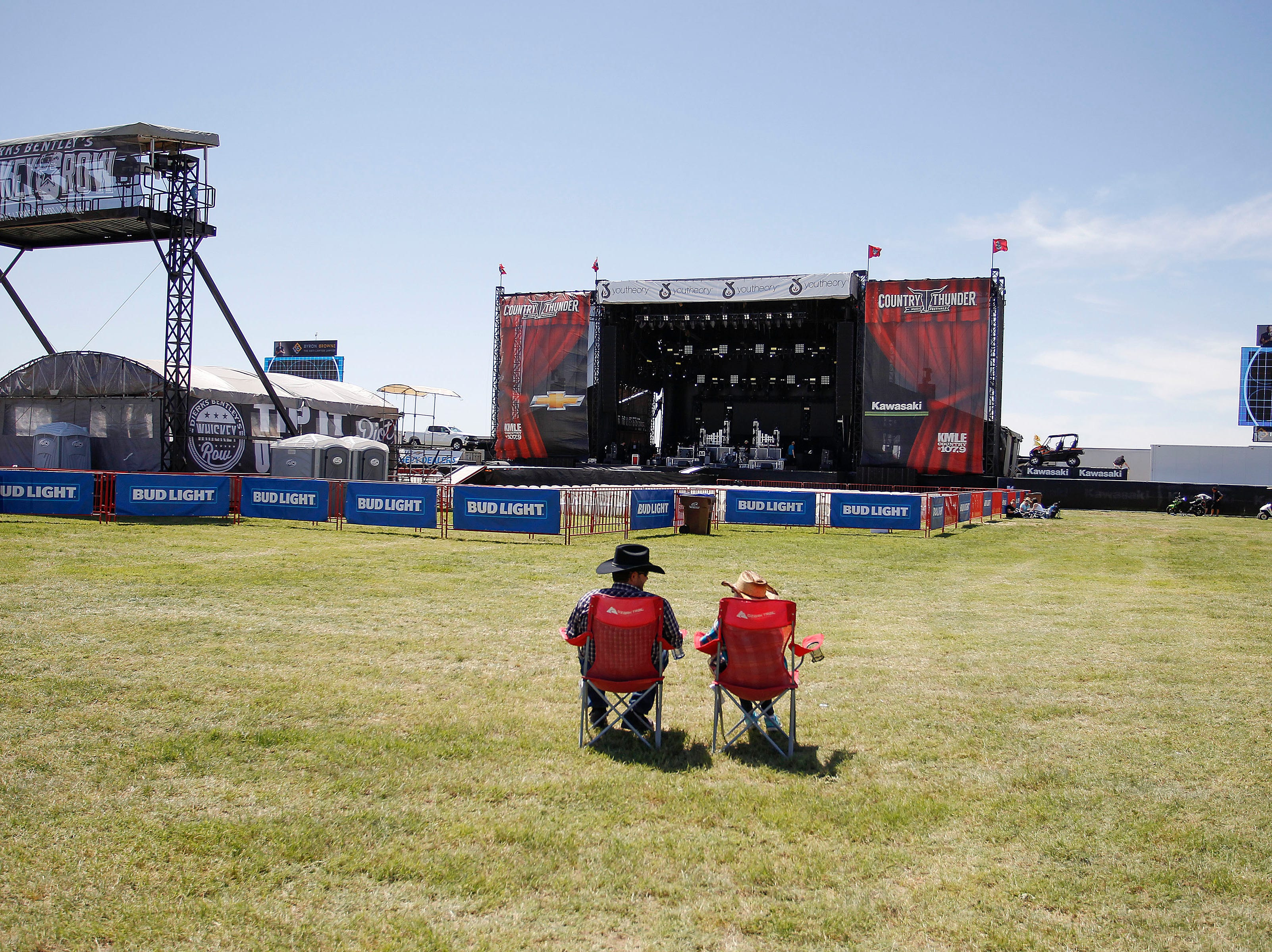 Two hours before the show, Kenneth Scott Jr. and Marian Scott of Tucson were some of the first to get a seat for the Cole Train show as Country Thunder Arizona gets underway on April 11, 2019, in Florence.