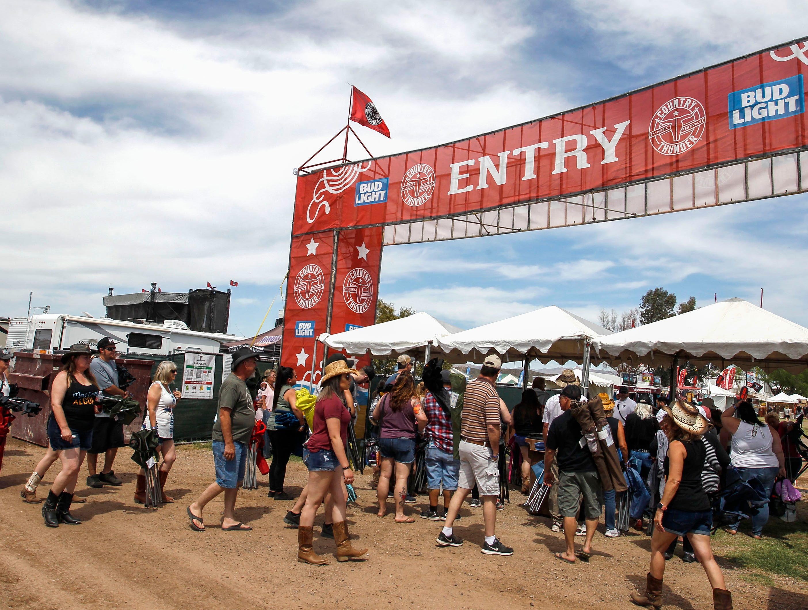 Country and Western music lovers wait for the gates to open to Country Thunder Arizona on April 11, 2019, in Florence.