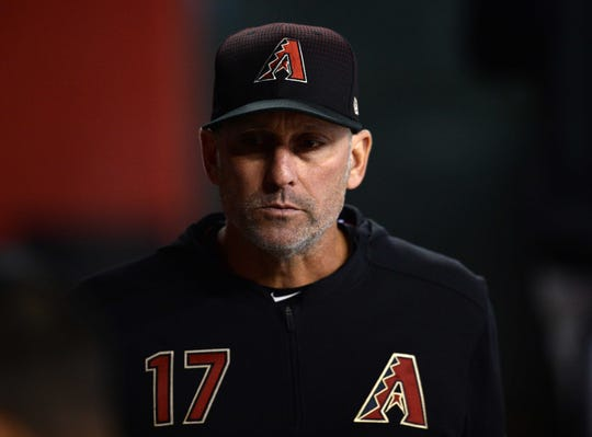Apr 10, 2019; Phoenix, AZ, USA; Arizona Diamondbacks manager Torey Lovullo (17) looks on against the Texas Rangers during the sixth inning at Chase Field. Mandatory Credit: Joe Camporeale-USA TODAY Sports