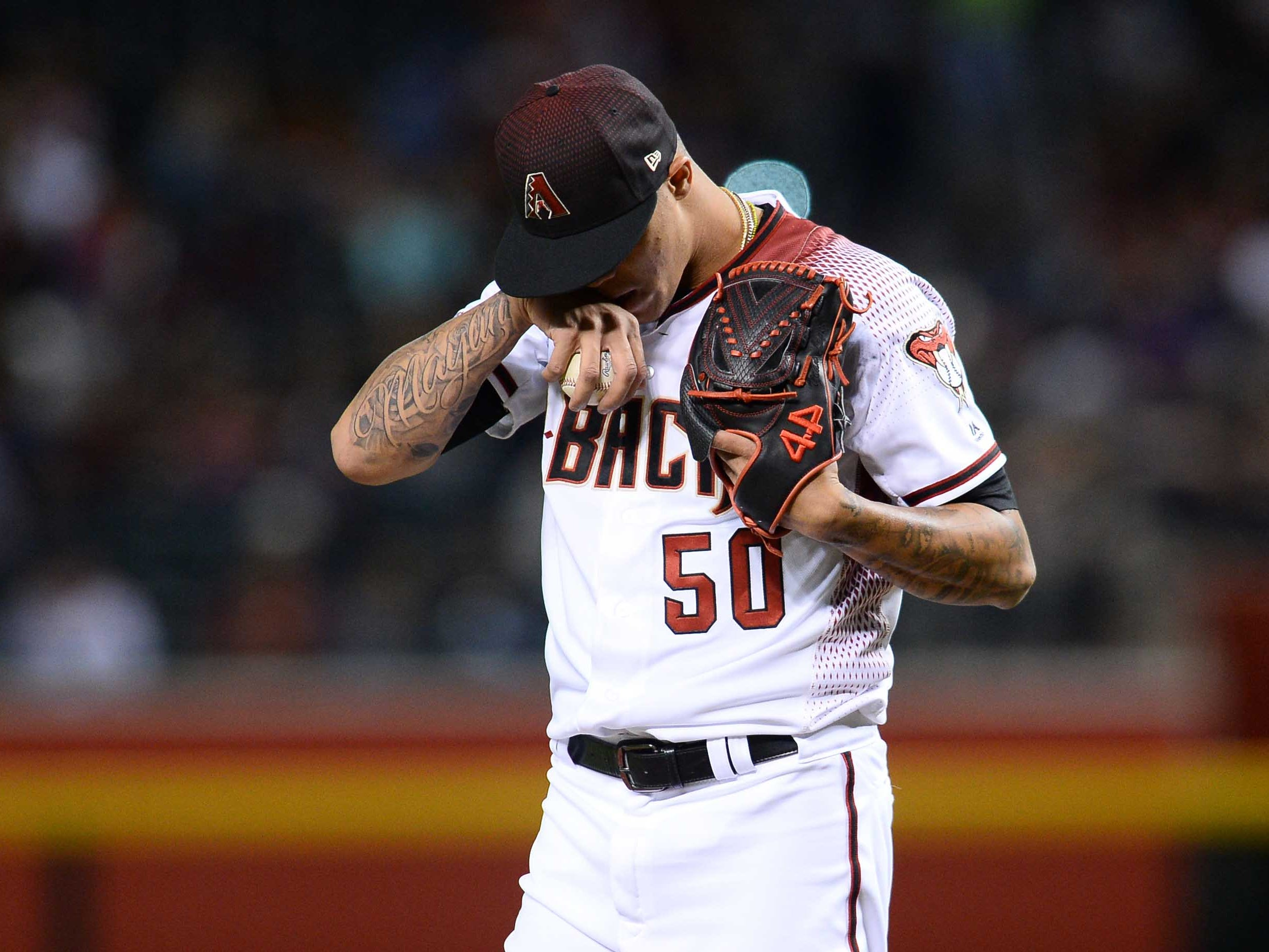 Apr 10, 2019; Phoenix, AZ, USA; Arizona Diamondbacks relief pitcher Yoan Lopez (50) reacts against the Texas Rangers during the sixth inning at Chase Field. Mandatory Credit: Joe Camporeale-USA TODAY Sports