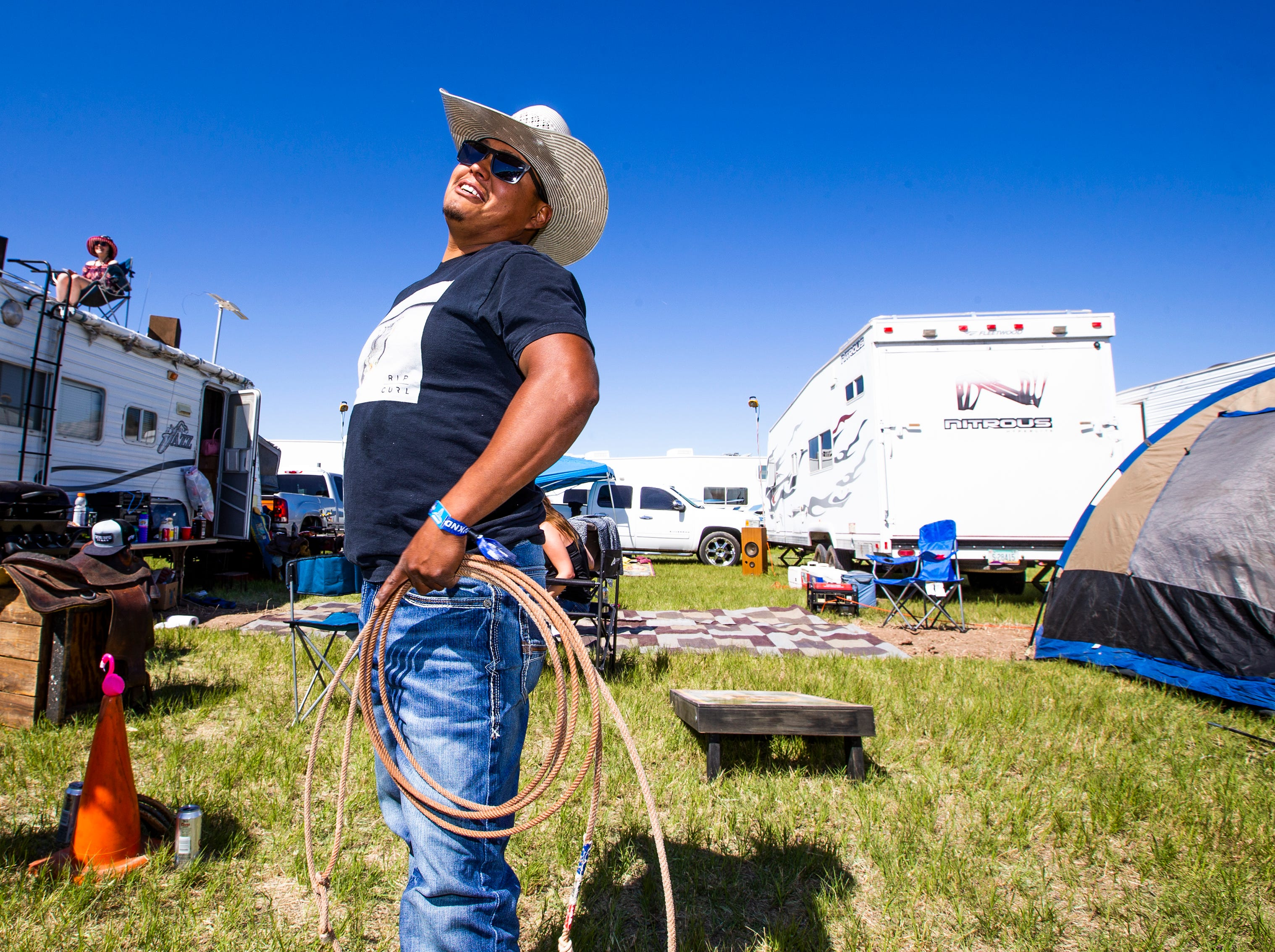 Jake Hosteen, 30, of Farmington, New Mexico, practices lassoing in his camp at the Country Thunder Arizona 2019 music festival April 11, 2019.