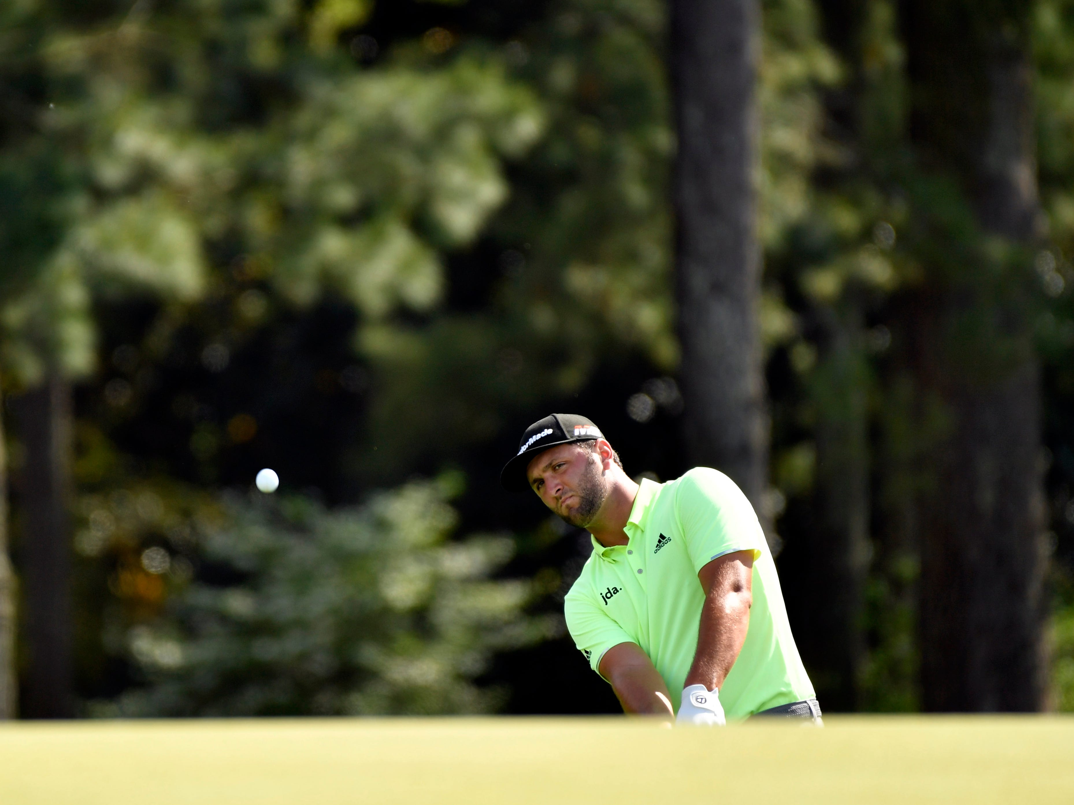 Apr 11, 2019; Augusta, GA, USA; Jon Rahm plays his approach to the 18th hole during the first round of The Masters golf tournament at Augusta National Golf Club.