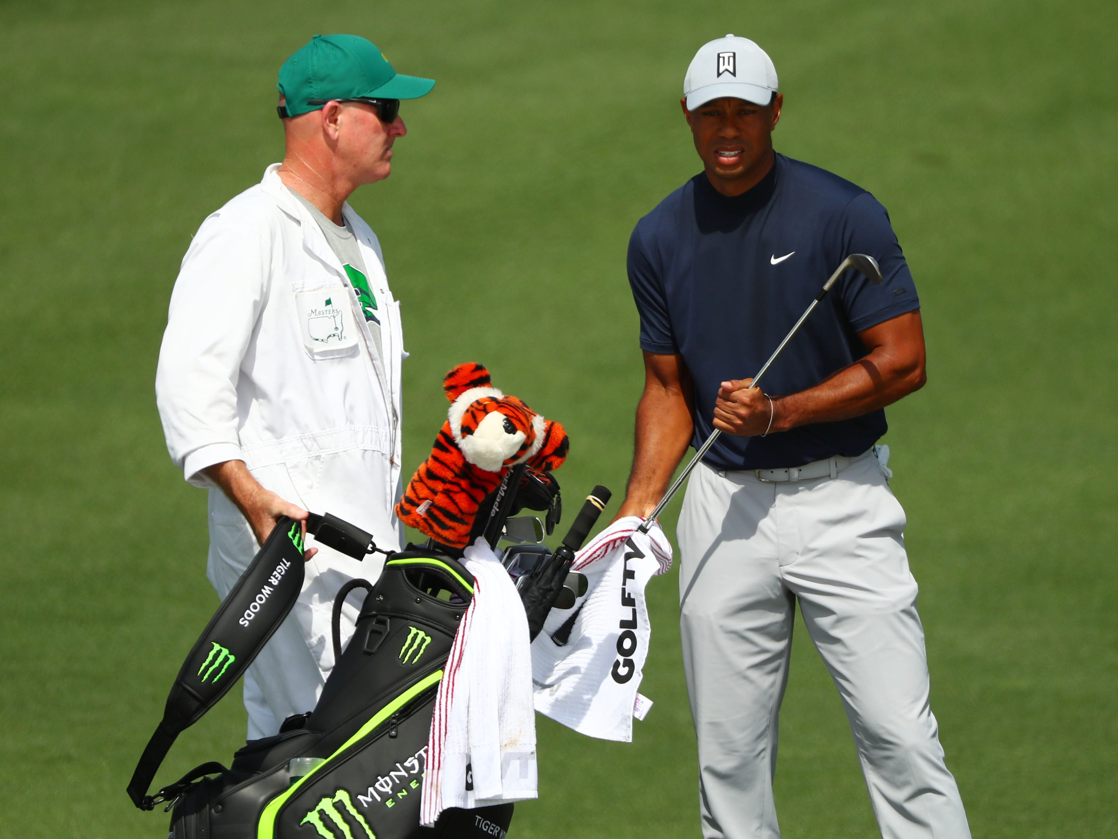 Apr 11, 2019; Augusta, GA, USA; Tiger Woods and caddie Joe Lacava look over a shot on the 2nd hole during the first round of The Masters golf tournament at Augusta National Golf Club.