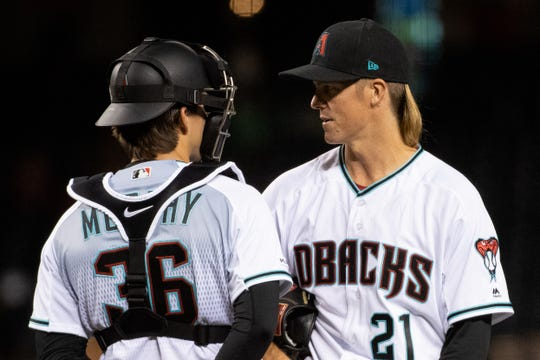 Zack Greinke talks with new batterymate John Ryan Murphy during Tuesday's game at Chase Field.