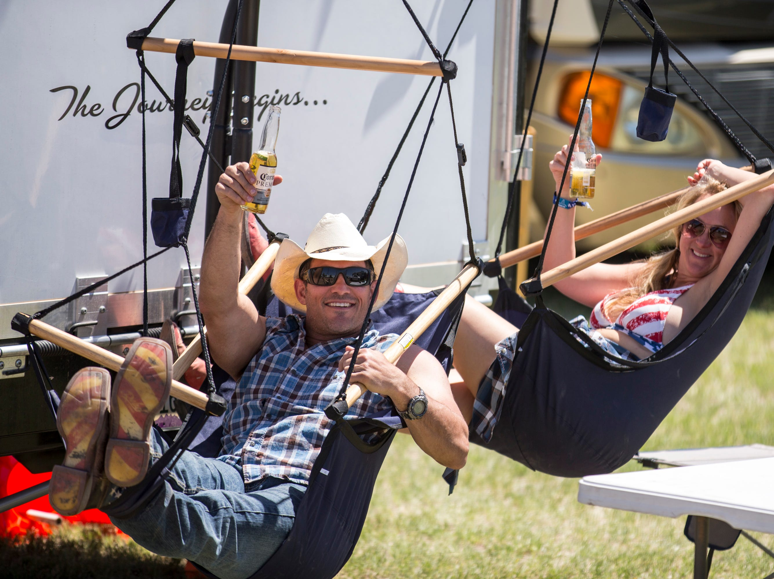 Ray Naylor and Corby Naylor relax outside their RV on April 11, 2019, during Day 1 of Country Thunder Arizona in Florence.