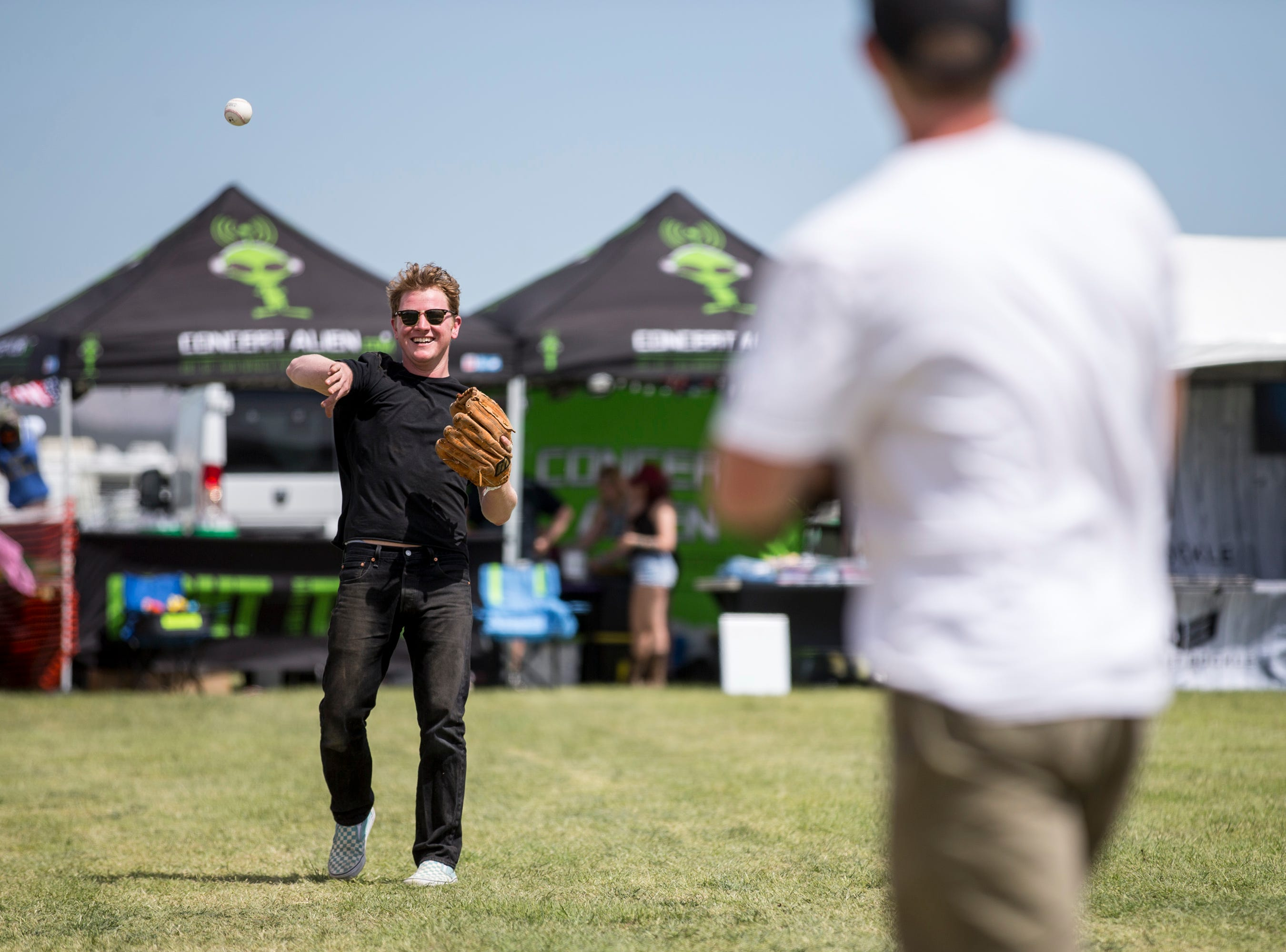 Tyler Sikora (left) plays catch with Christian Dean on April 11, 2019, during Day 1 of Country Thunder Arizona in Florence.