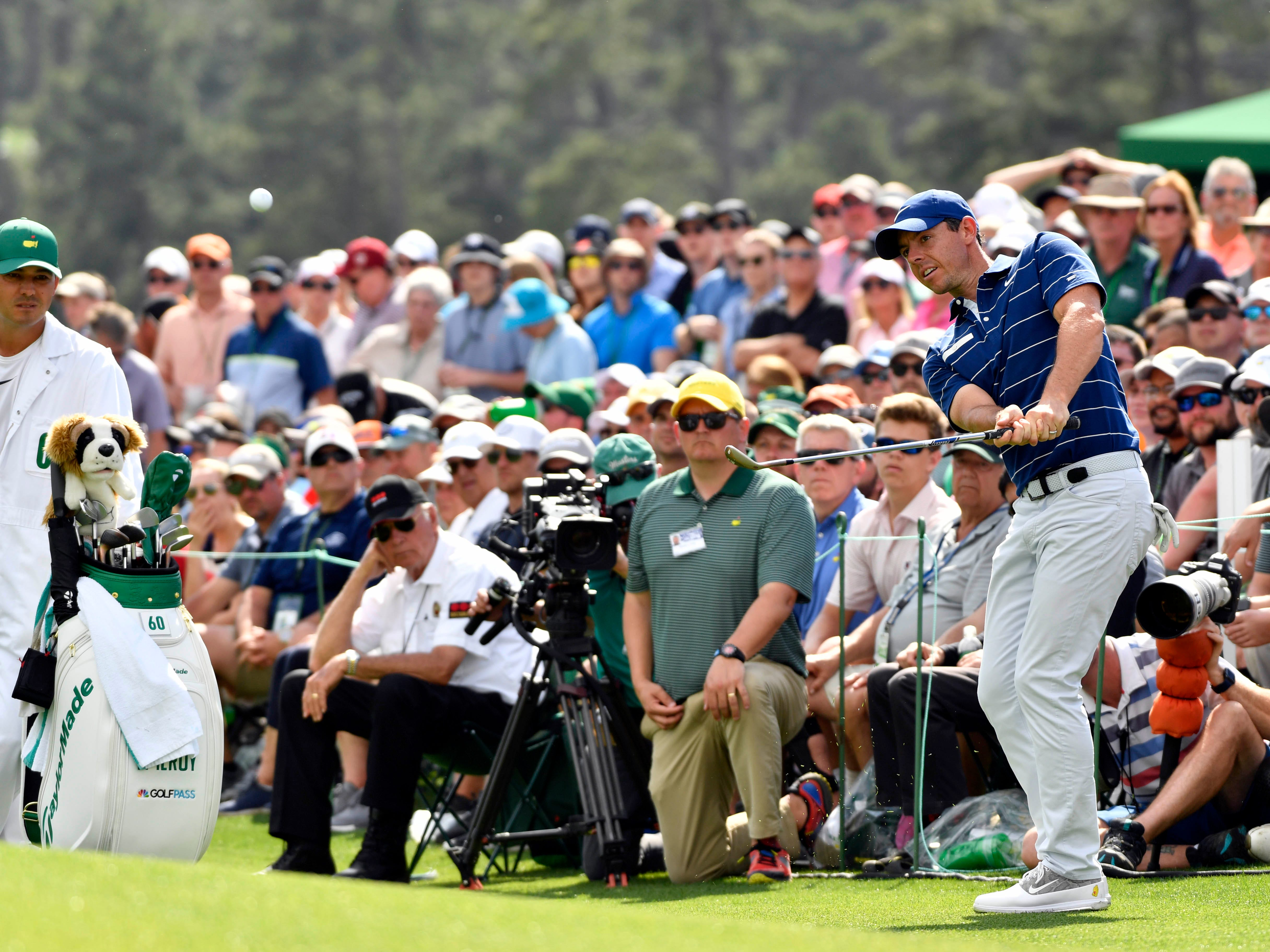 Apr 11, 2019; Augusta, GA, USA; Rory McIlroy chips onto the 18th green during the first round of The Masters golf tournament at Augusta National Golf Club.