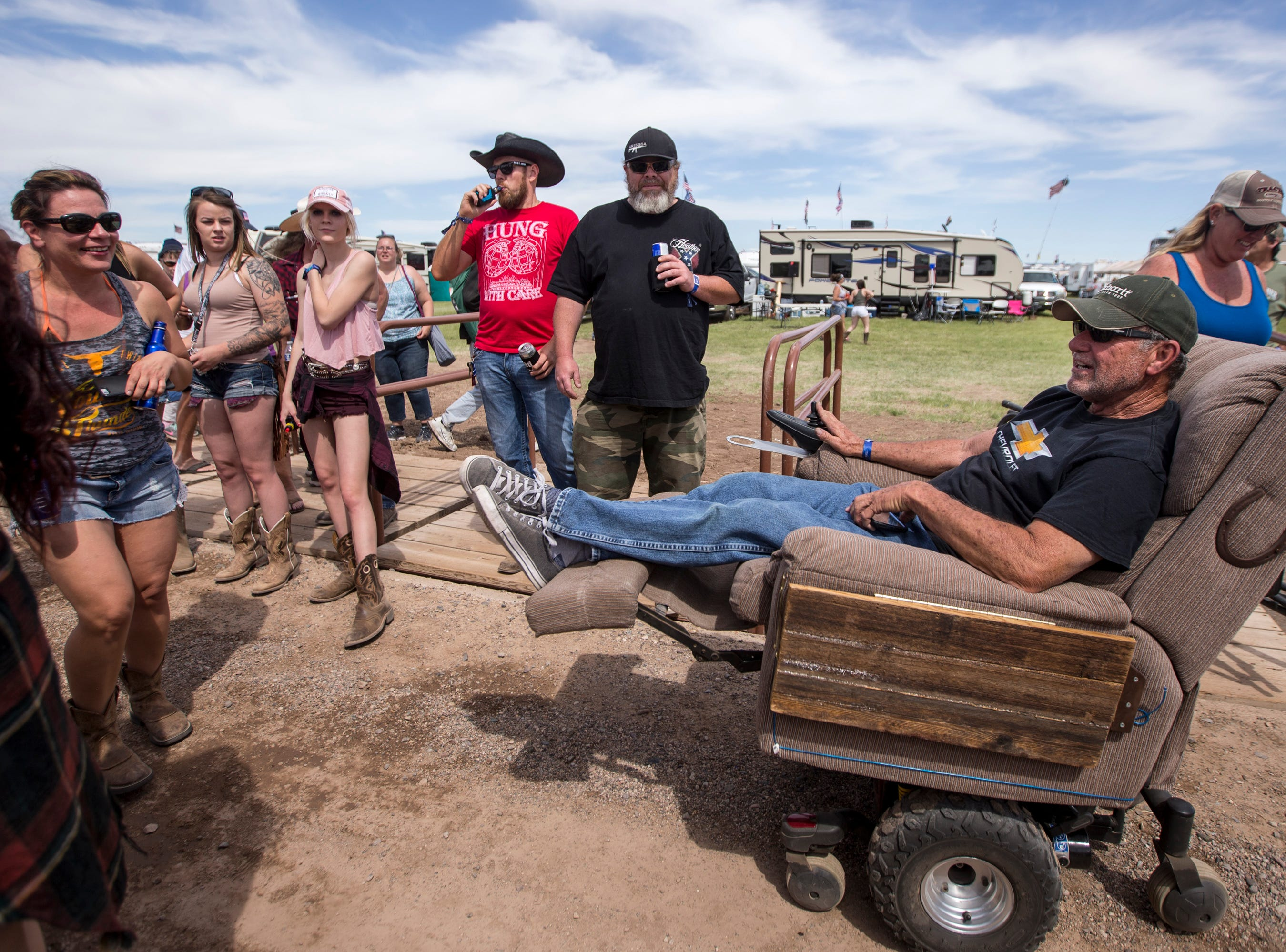 Kip Pageau drives his scooter chair near the entrance on April 11, 2019, during Day 1 of Country Thunder Arizona in Florence.