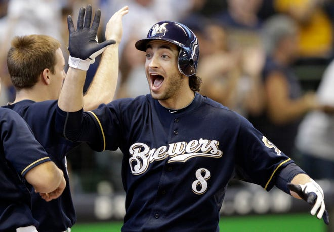 Milwaukee Brewers' Ryan Braun  celebrates after homering against the Diamondbacks in the 2011 playoffs. He won the MVP award that year, but later was suspended for nearly half a season after being accused of using performance enhancing drugs.