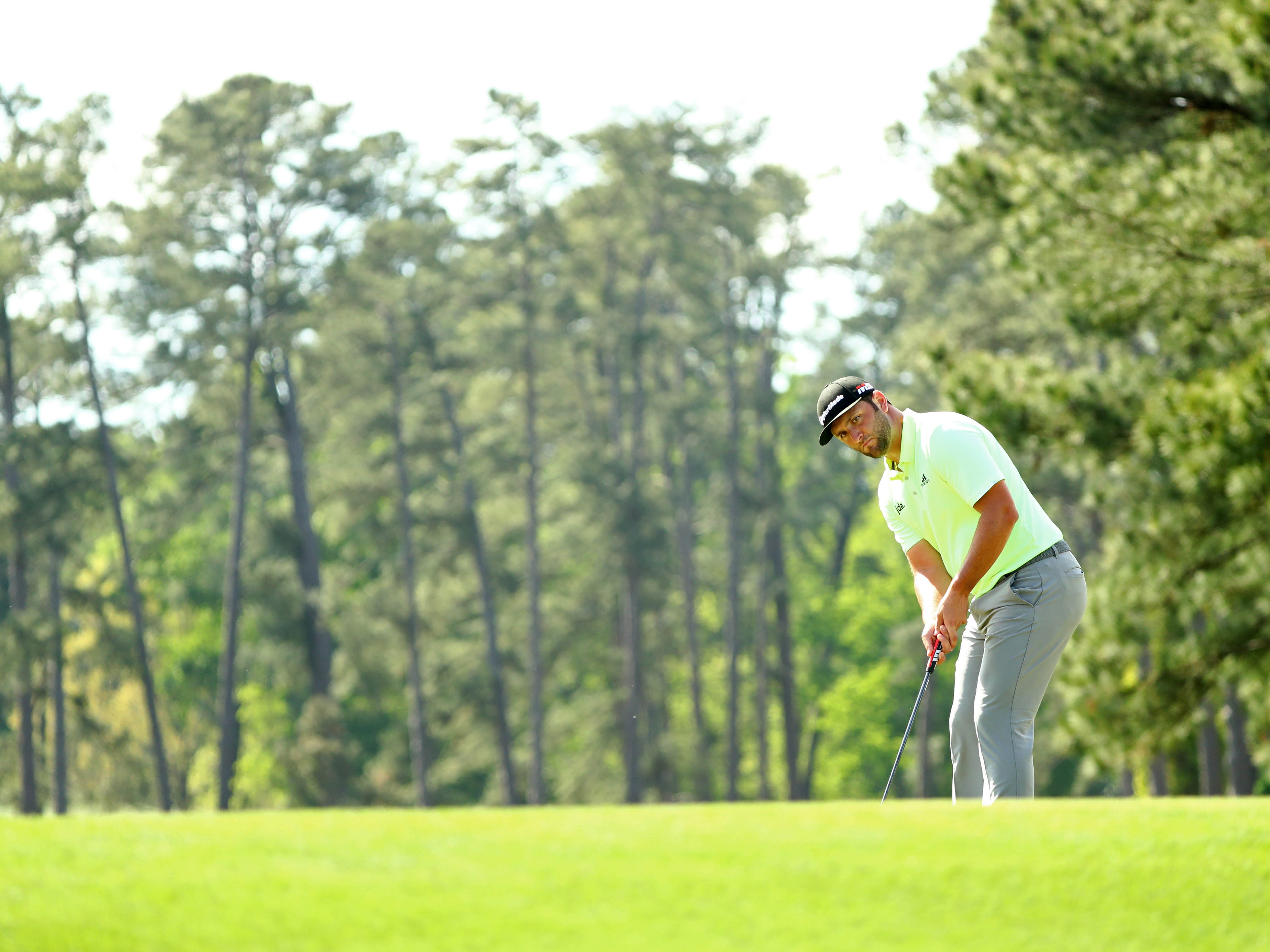 Apr 11, 2019; Augusta, GA, USA; Jon Rahm putts on the 17th green during the first round of The Masters golf tournament at Augusta National Golf Club.