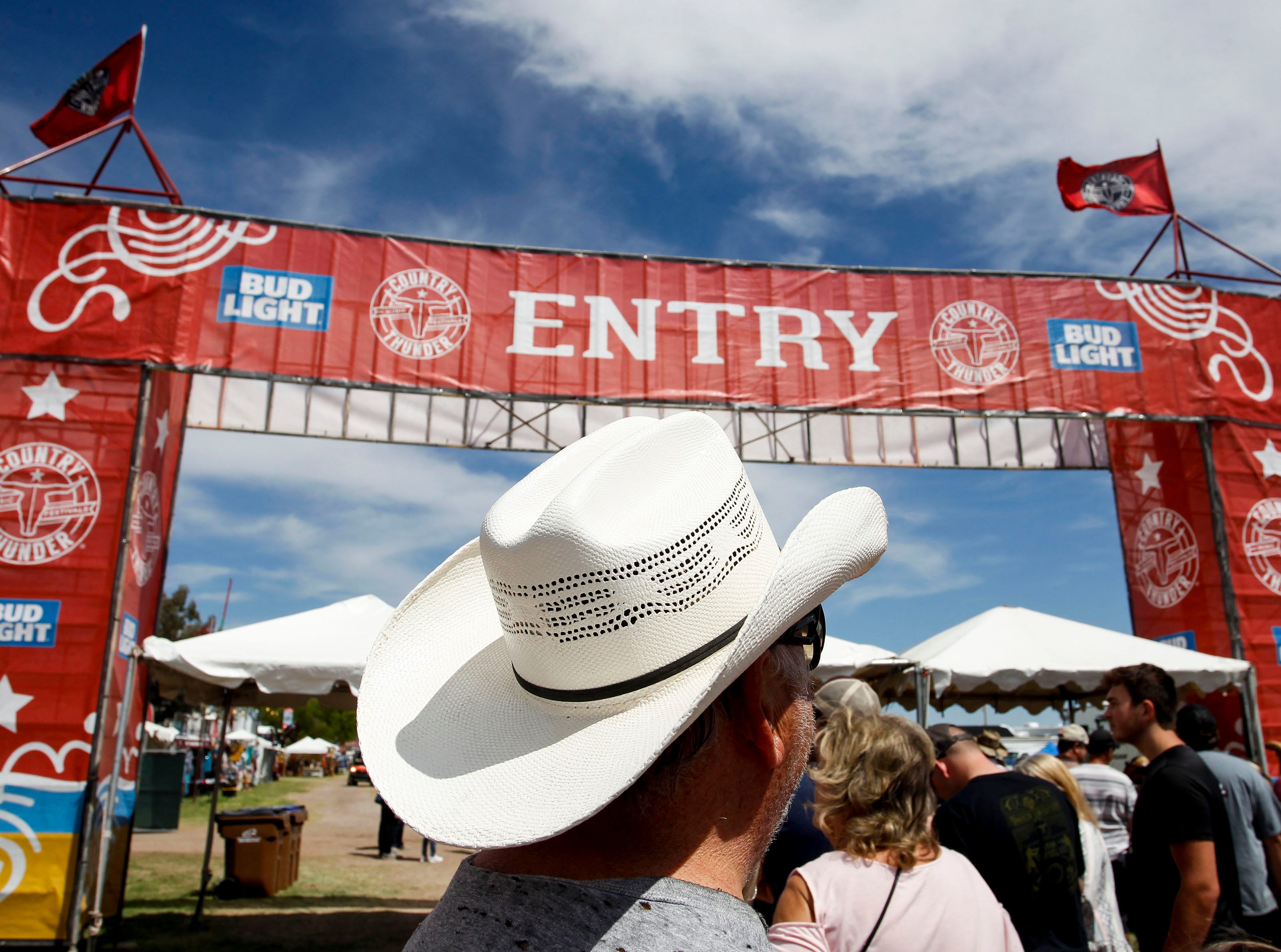 Marcel Huizing of Gilbert waits for the gates to open to Country Thunder Arizona on April 11, 2019, in Florence.