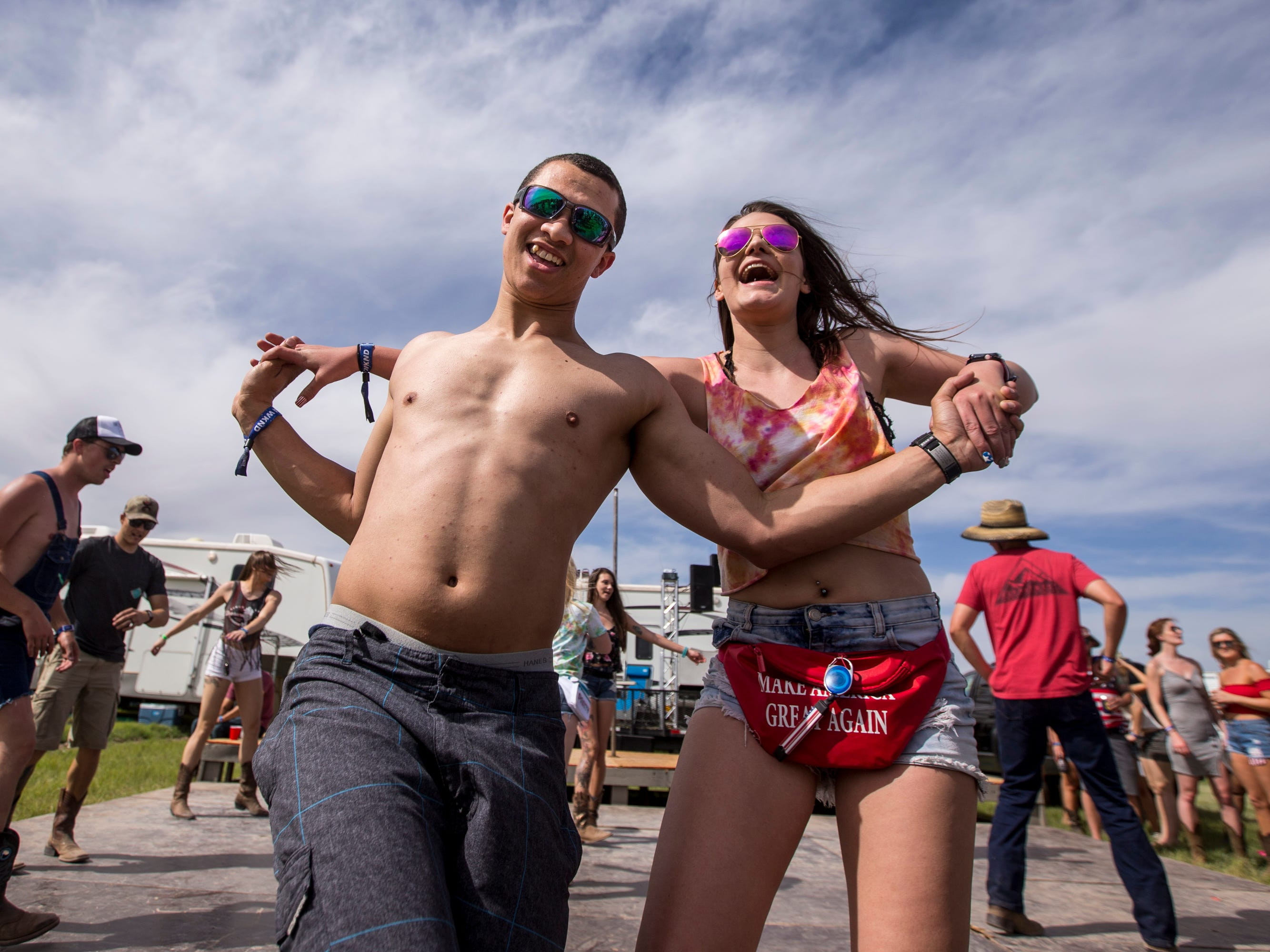 Alex Firth and Taylor Graff dance at the Crazy Coyote campsite on April 11, 2019, during Day 1 of Country Thunder Arizona in Florence.