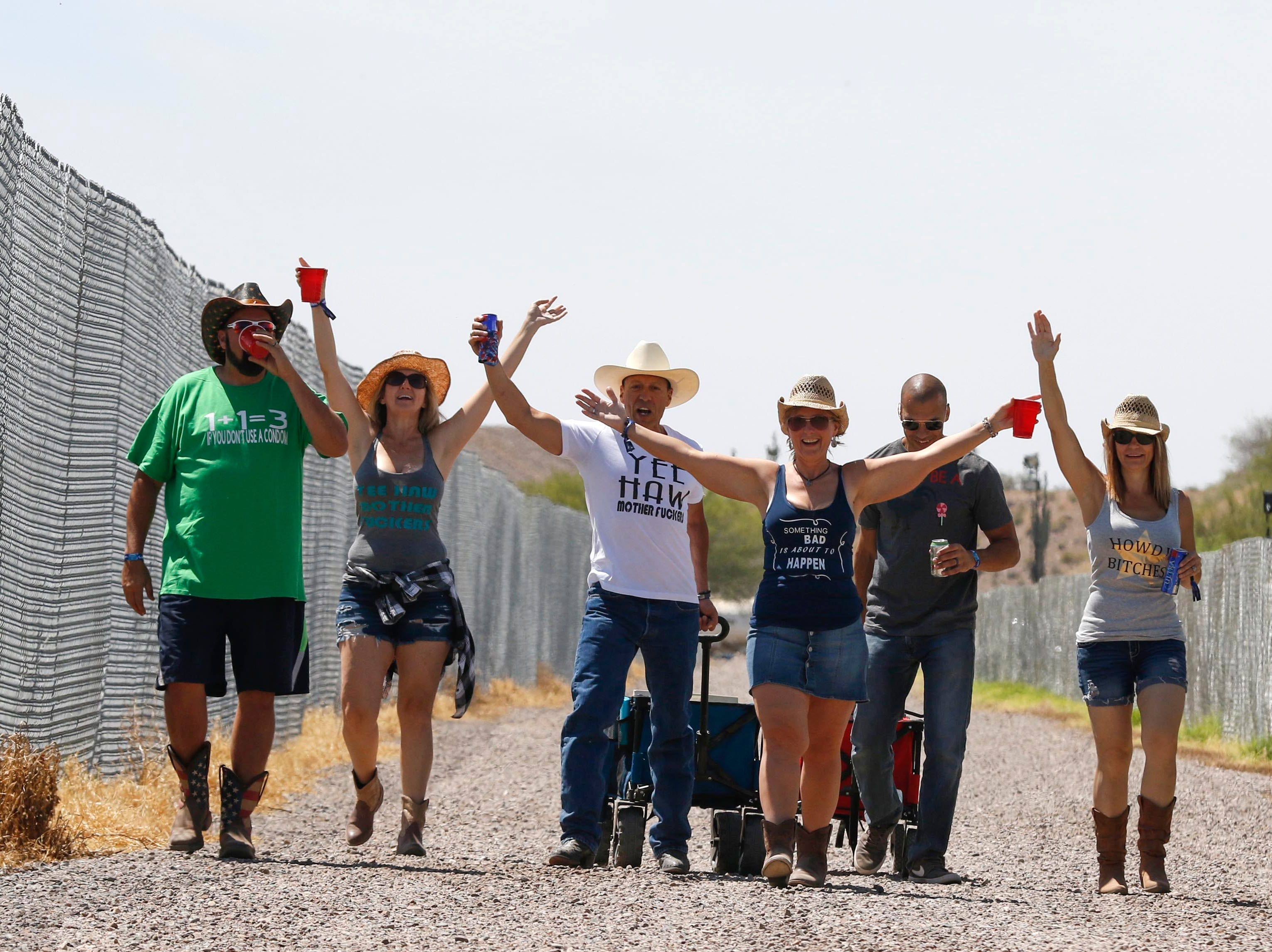 Country and Western music lovers make their way towards the stages during Country Thunder Arizona on April 11, 2019, in Florence.