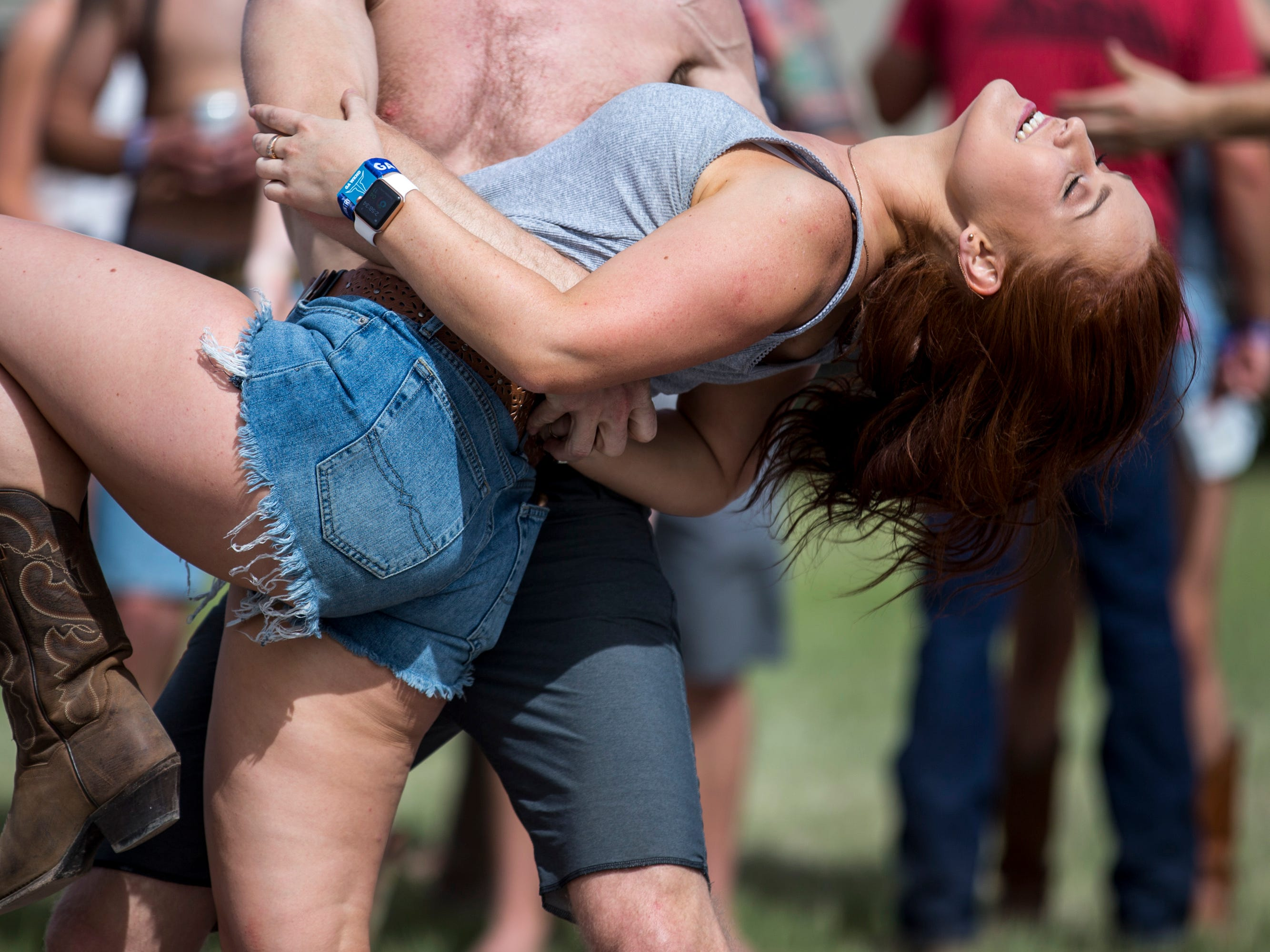 Daniel Rose dips Yuliya Ignatyeva at the Crazy Coyote campsite on April 11, 2019, during Day 1 of Country Thunder Arizona in Florence.