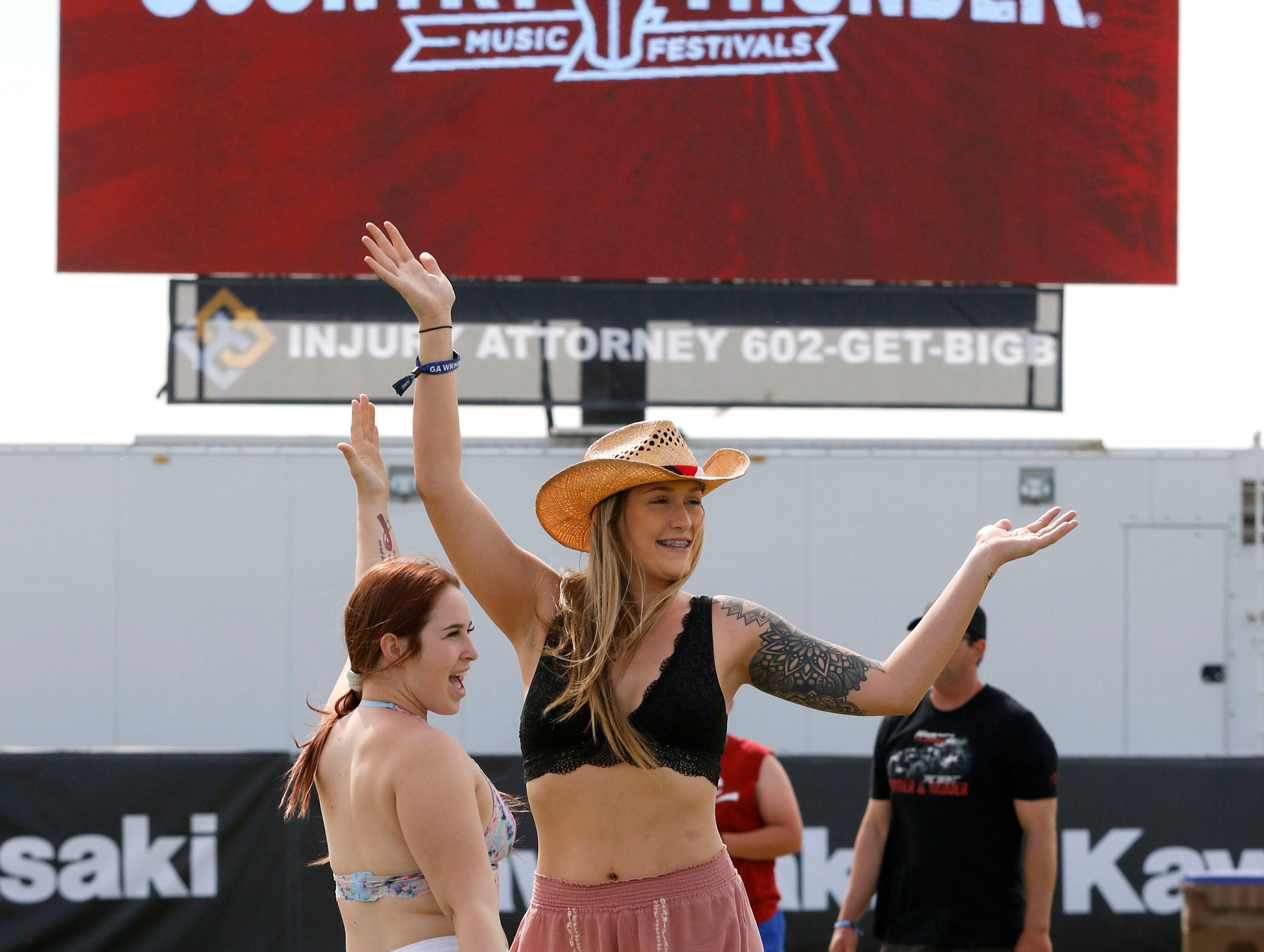 Mariah Townsend of Surprise and Katie Mallory of Wickenburg have a little fun while posing for a picture during Country Thunder Arizona on April 11, 2019, in Florencea.