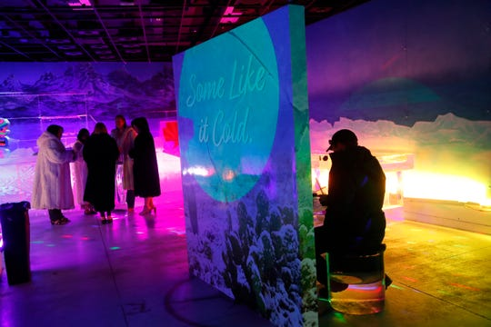 Visitors cool off at the Polar Play Ice Bar in Scottsdale, Ariz. April 10, 2019. The family-friendly attraction in Scottsdale has ice sculptures, games and more.
