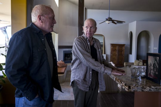 Paul Winters (left) talks with his stepfather, Gahan Wilson, on March 22, 2019. Winters and his wife are moving to a ranch in New Mexico, and Wilson will move to a memory care facility near their new home.