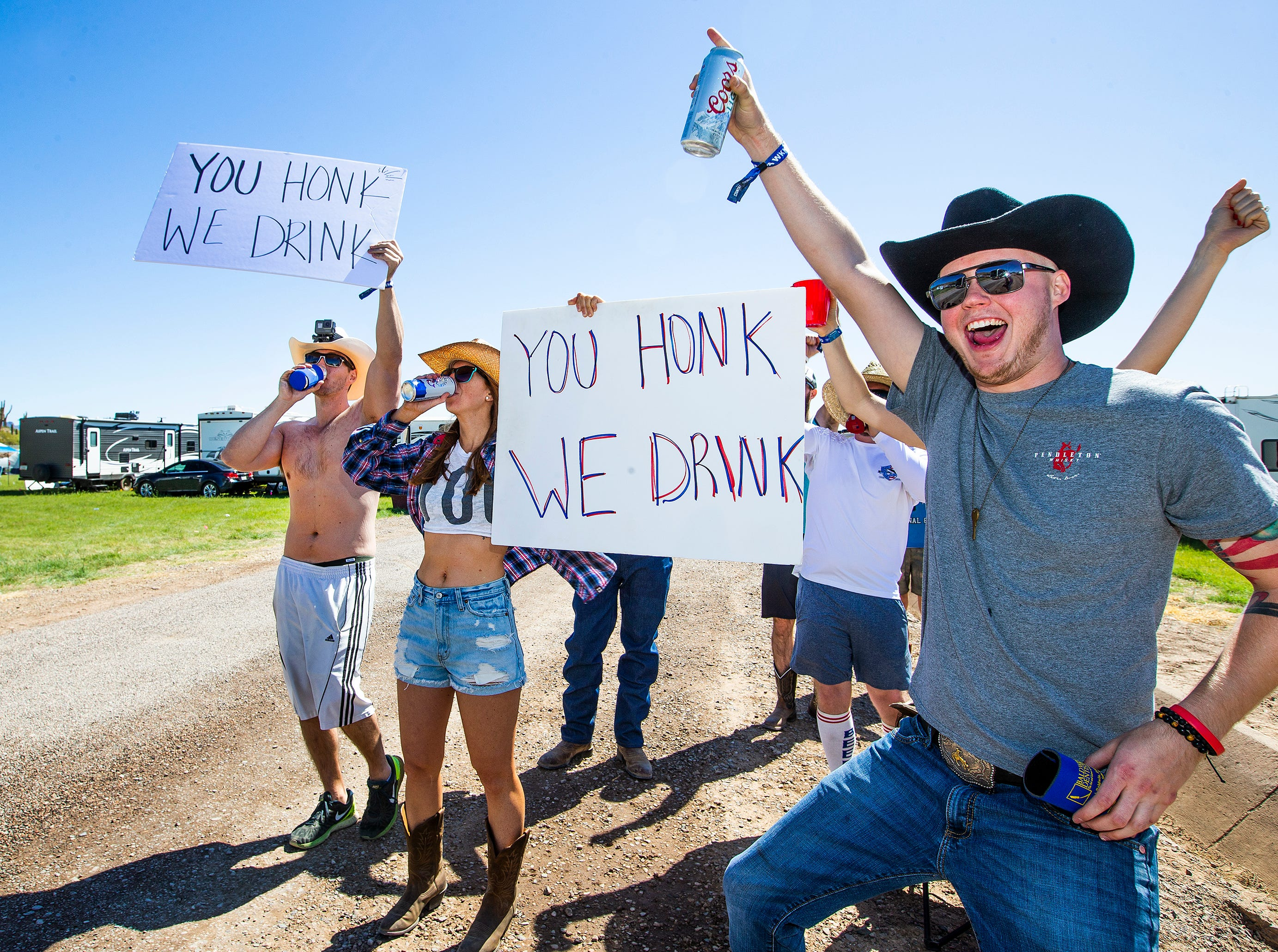 Early-morning risers get the party started by getting people to honk as they enter the Country Thunder Arizona 2019 music festival April 11, 2019.