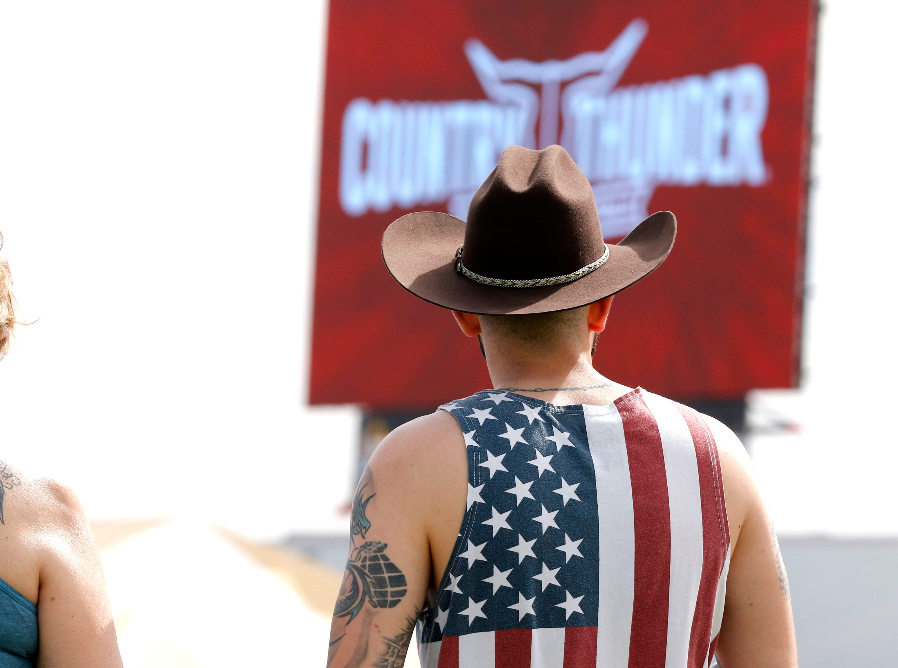 David Duff of Tucson waits for the music to start during Country Thunder Arizona on April 11, 2019, in Florence.