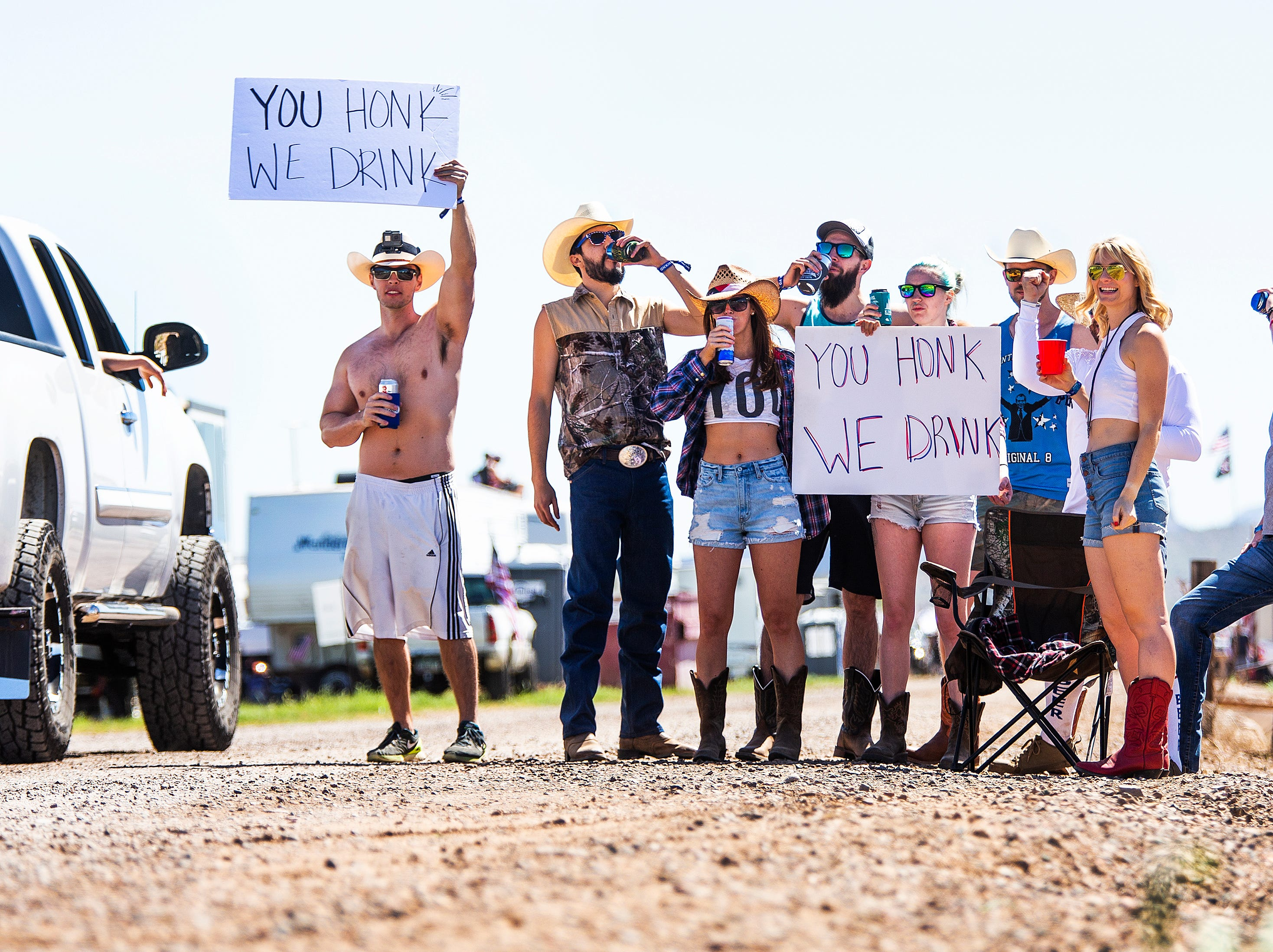 Early morning risers get the party started by getting people to honk as they enter the Country Thunder Arizona 2019 music festival April 11, 2019.
