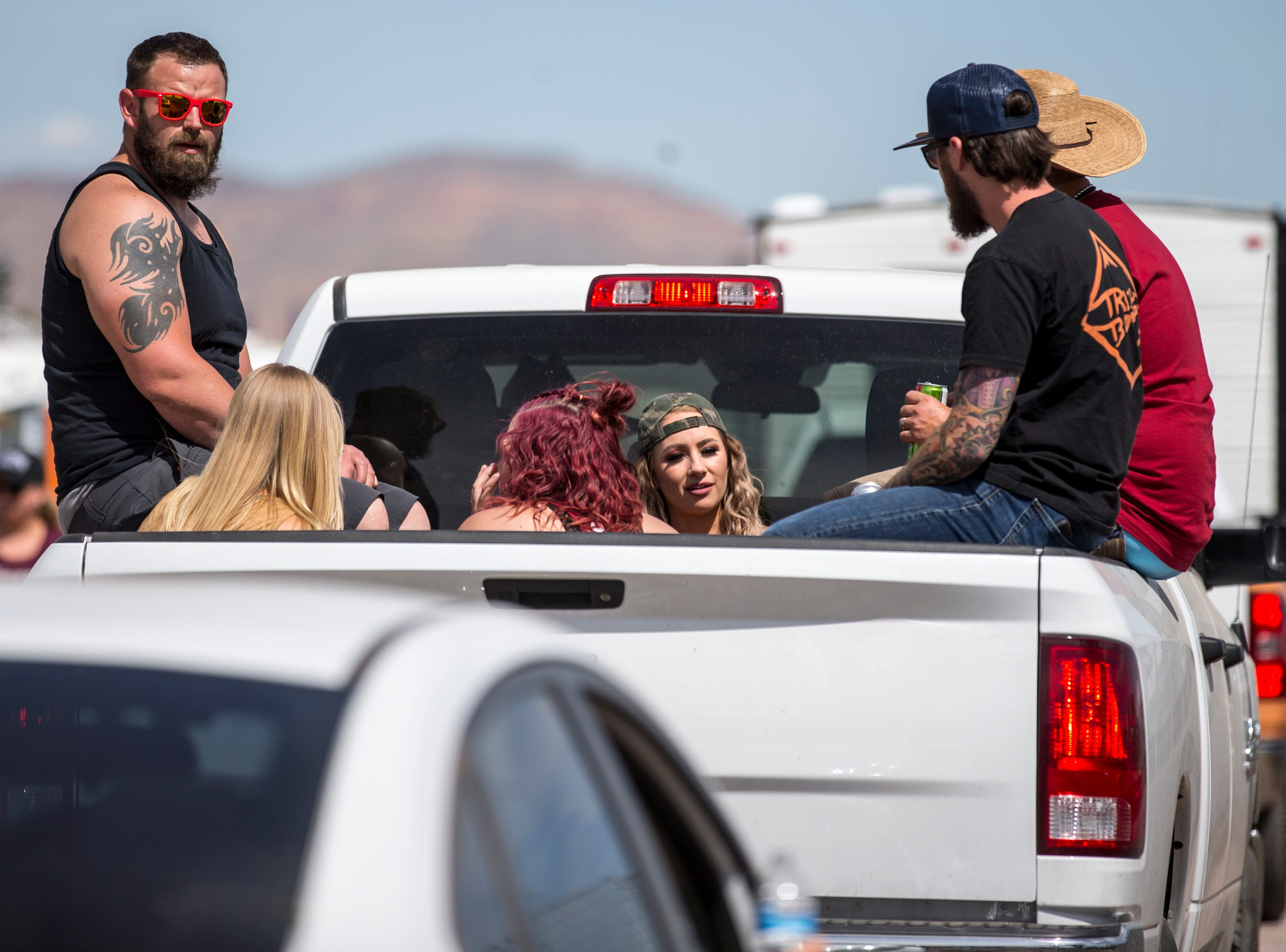 Festival-goers drive by campsites on April 11, 2019, during Day 1 of Country Thunder Arizona in Florence.