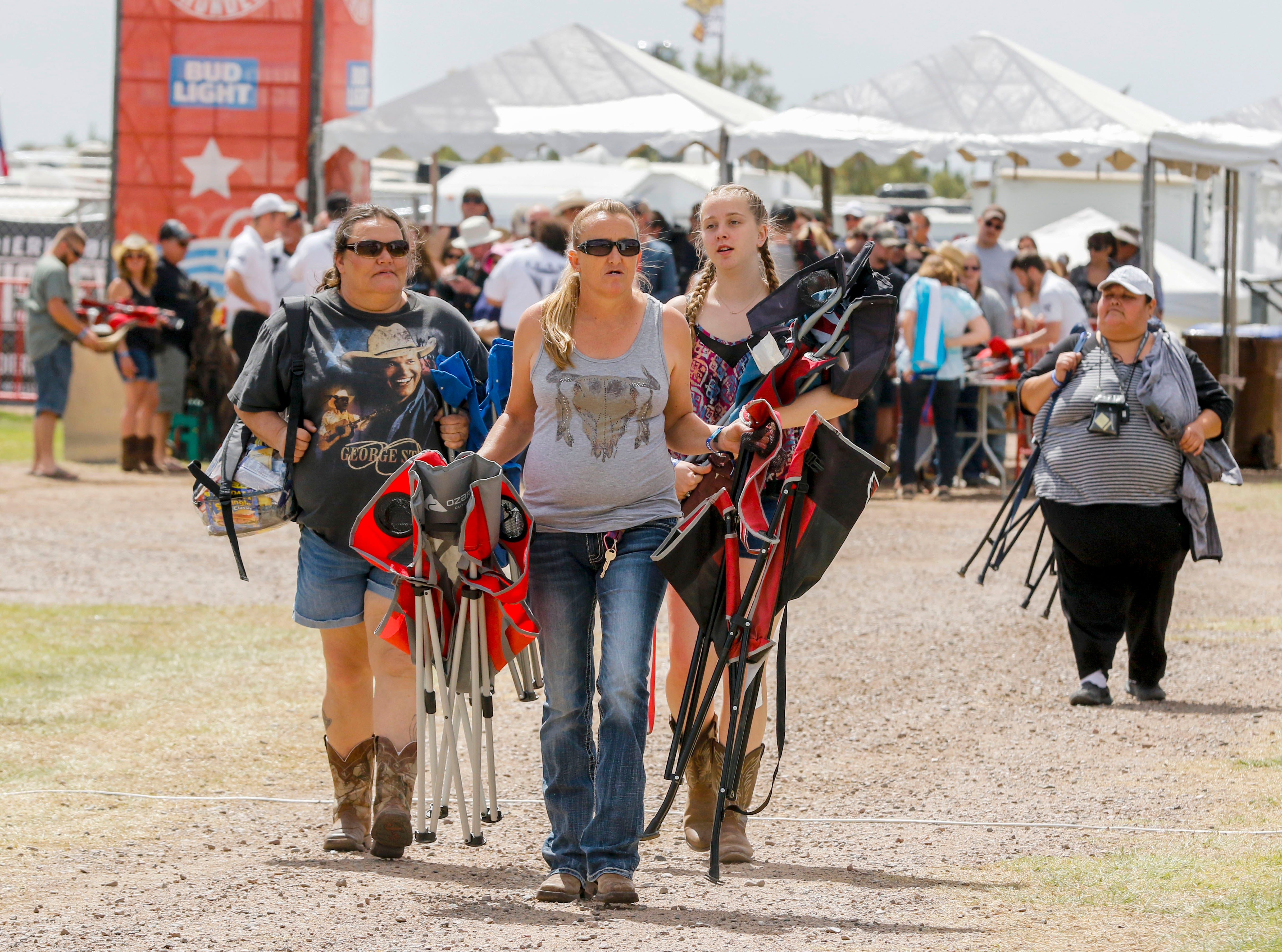 Armed with chairs, fans make their way into Country Thunder Arizona on April 11, 2019, in Florence.