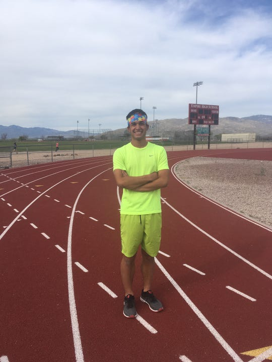 For races at track meets, Tucson Empire High School runner Brendan Torres proudly wears his autism awareness bandanna.