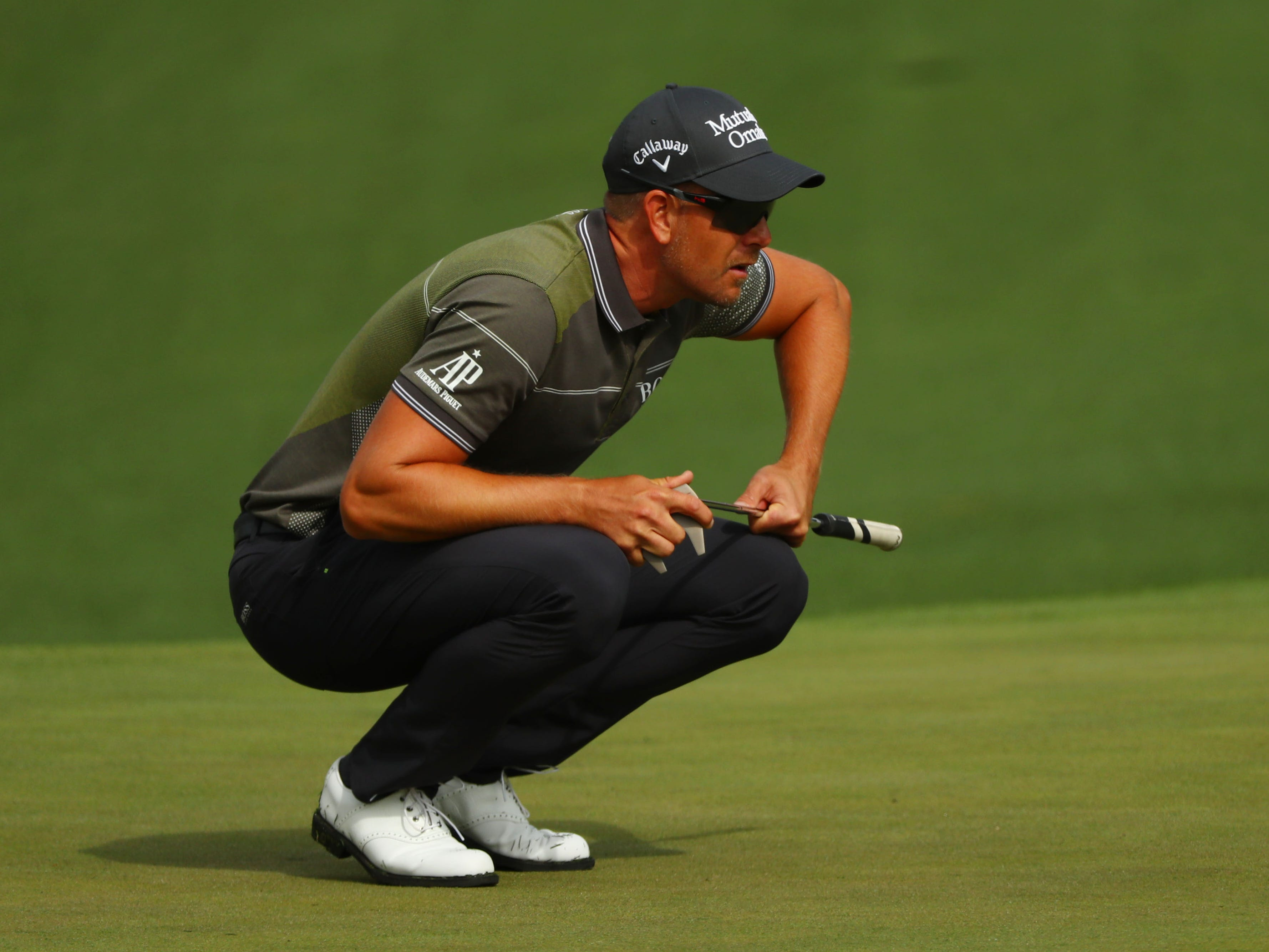 Apr 11, 2019; Augusta, GA, USA; Henrik Stenson lines up a putt on the 2nd green during the first round of The Masters golf tournament at Augusta National Golf Club.