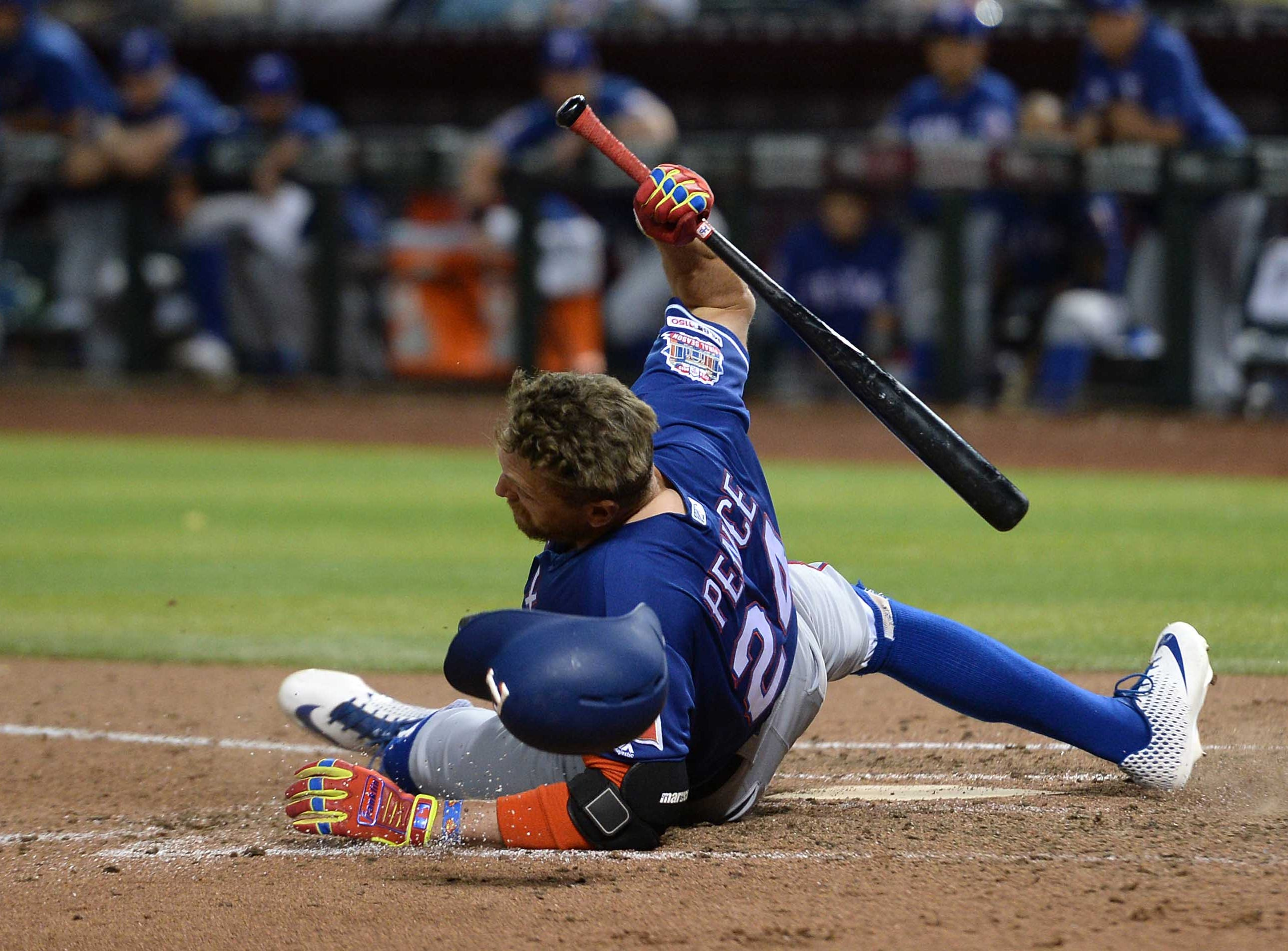 Apr 10, 2019; Phoenix, AZ, USA; Texas Rangers right fielder Hunter Pence (24) hits the ground while avoiding a pitch against the Arizona Diamondbacks during the sixth inning at Chase Field. Mandatory Credit: Joe Camporeale-USA TODAY Sports