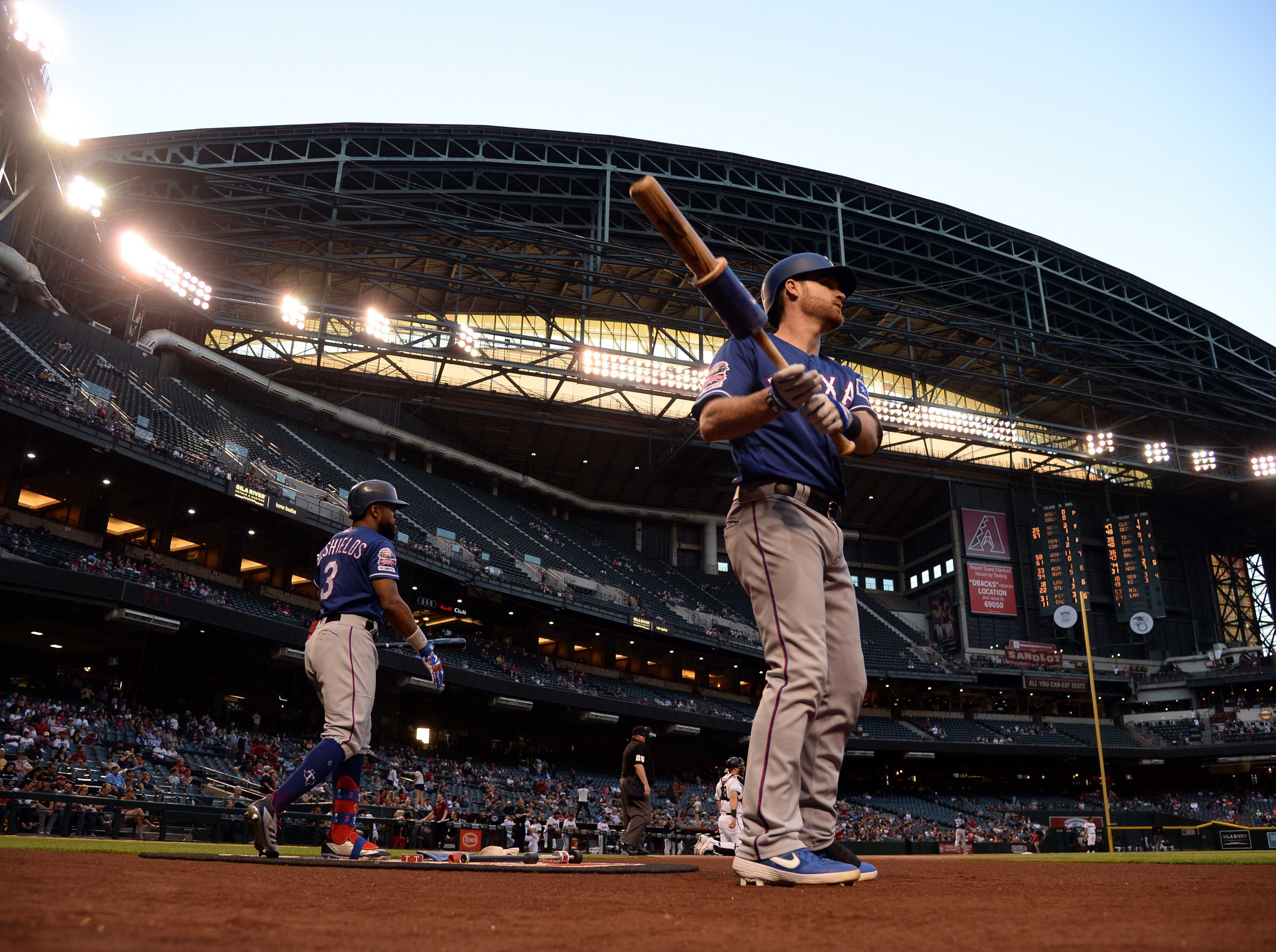 Apr 10, 2019; Phoenix, AZ, USA; Texas Rangers second baseman Logan Forsythe (41) and Texas Rangers left fielder Delino DeShields (3) wait in the on dec area against the Arizona Diamondbacks during the first inning at Chase Field. Mandatory Credit: Joe Camporeale-USA TODAY Sports