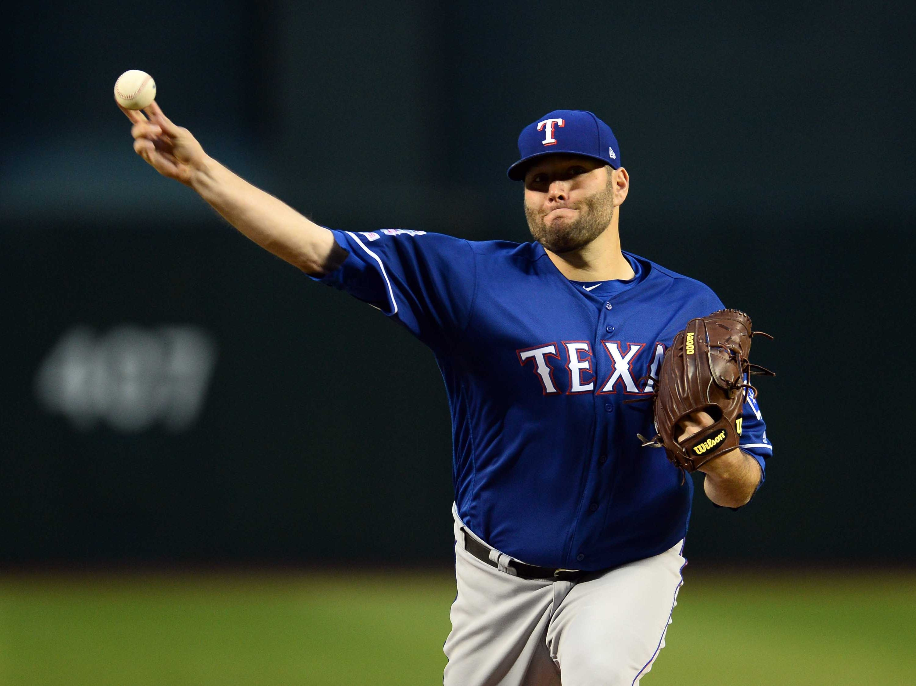 Apr 10, 2019; Phoenix, AZ, USA; Texas Rangers starting pitcher Lance Lynn (35) pitches against the Arizona Diamondbacks during the first inning at Chase Field. Mandatory Credit: Joe Camporeale-USA TODAY Sports