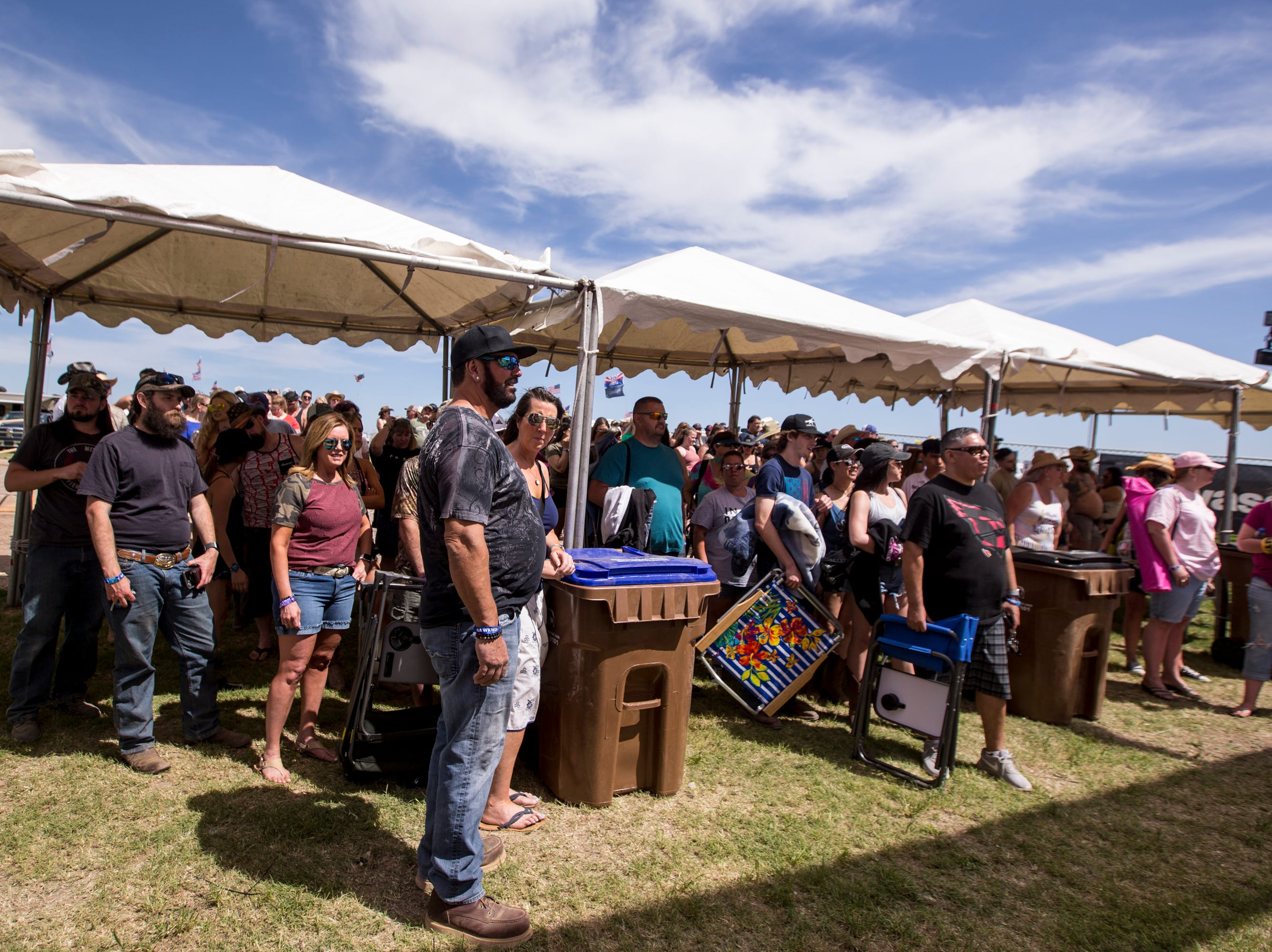 Festival-goers wait in line at the entrance on April 11, 2019, during Day 1 of Country Thunder Arizona in Florence.
