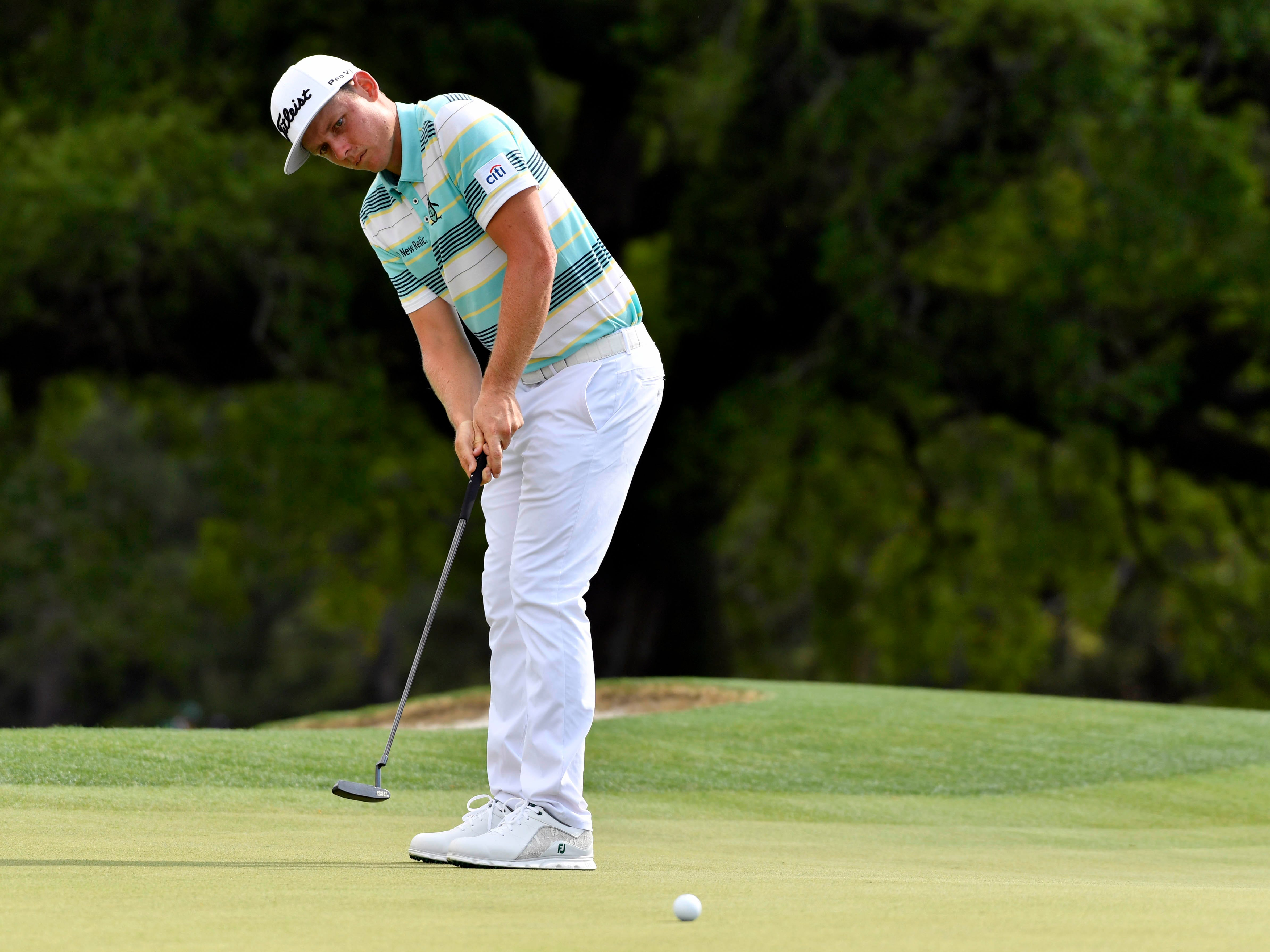 Apr 11, 2019; Augusta, GA, USA; Cameron Smith putts on the 18th green during the first round of The Masters golf tournament at Augusta National Golf Club.