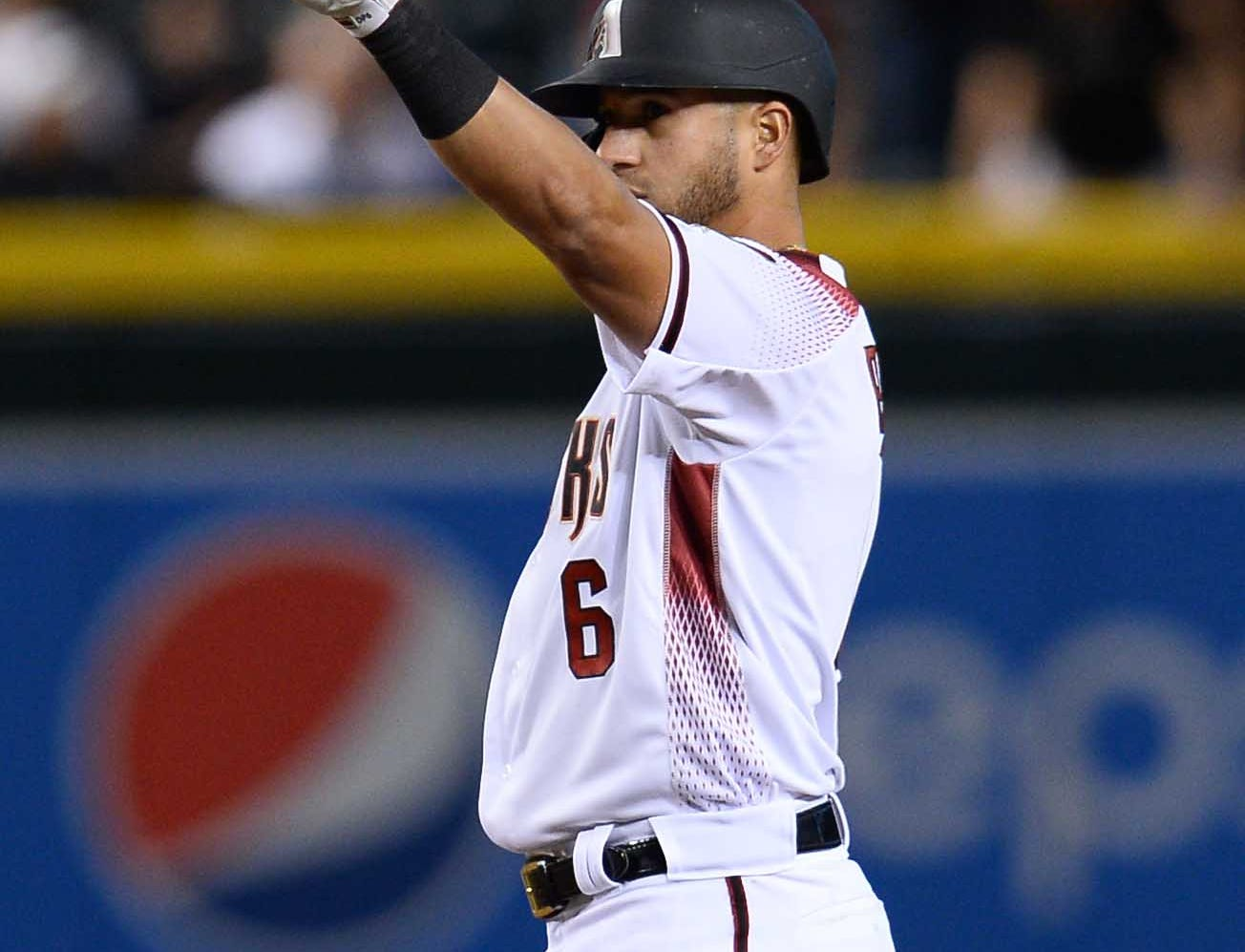 Apr 10, 2019; Phoenix, AZ, USA; Arizona Diamondbacks right fielder David Peralta (6) reacts after hitting a double against the Texas Rangers during the third inning at Chase Field. Mandatory Credit: Joe Camporeale-USA TODAY Sports
