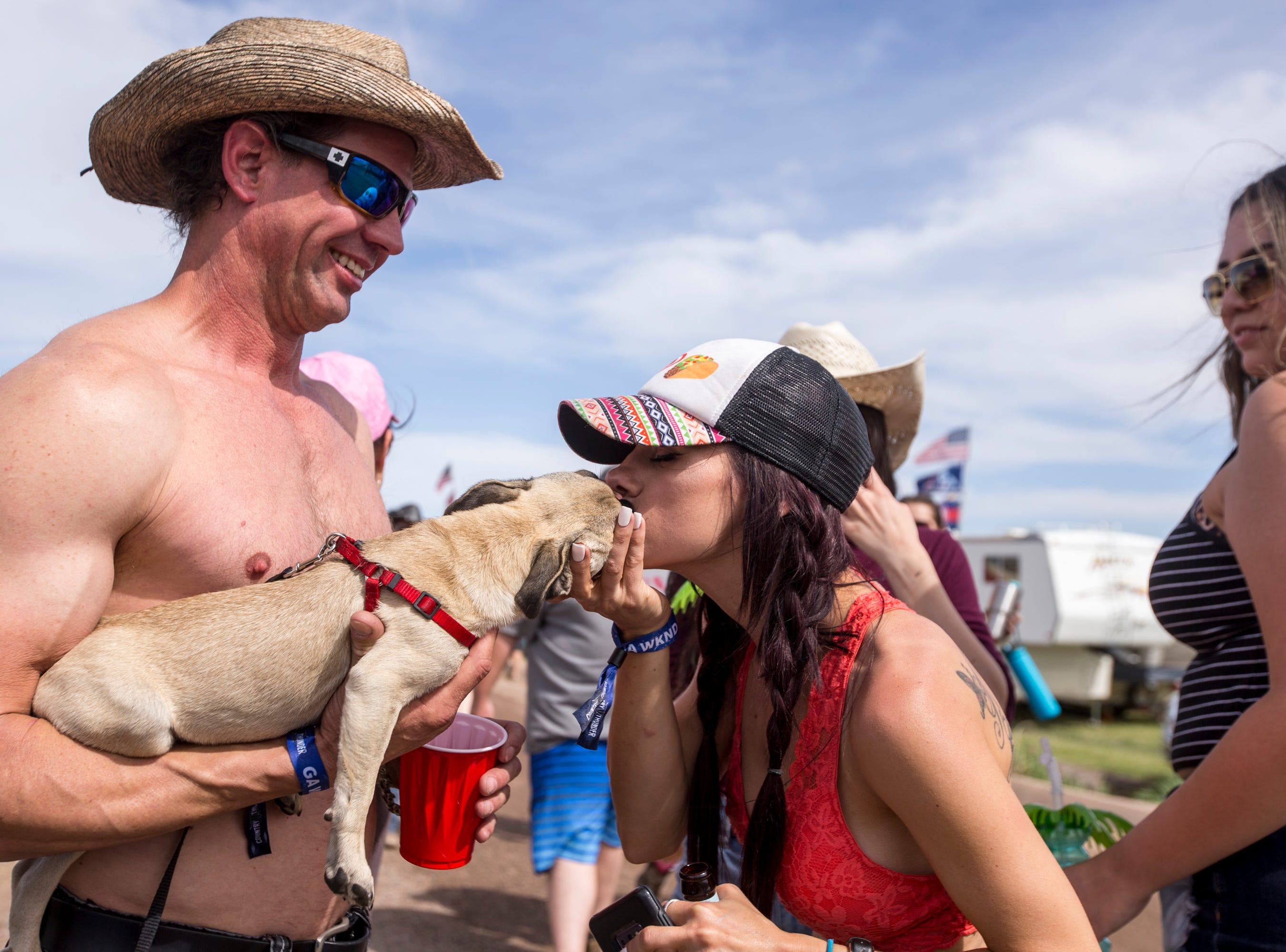 Codi Carr kisses Dan Lundell's dog, Zoey, on April 11, 2019, during Day 1 of Country Thunder Arizona in Florence.