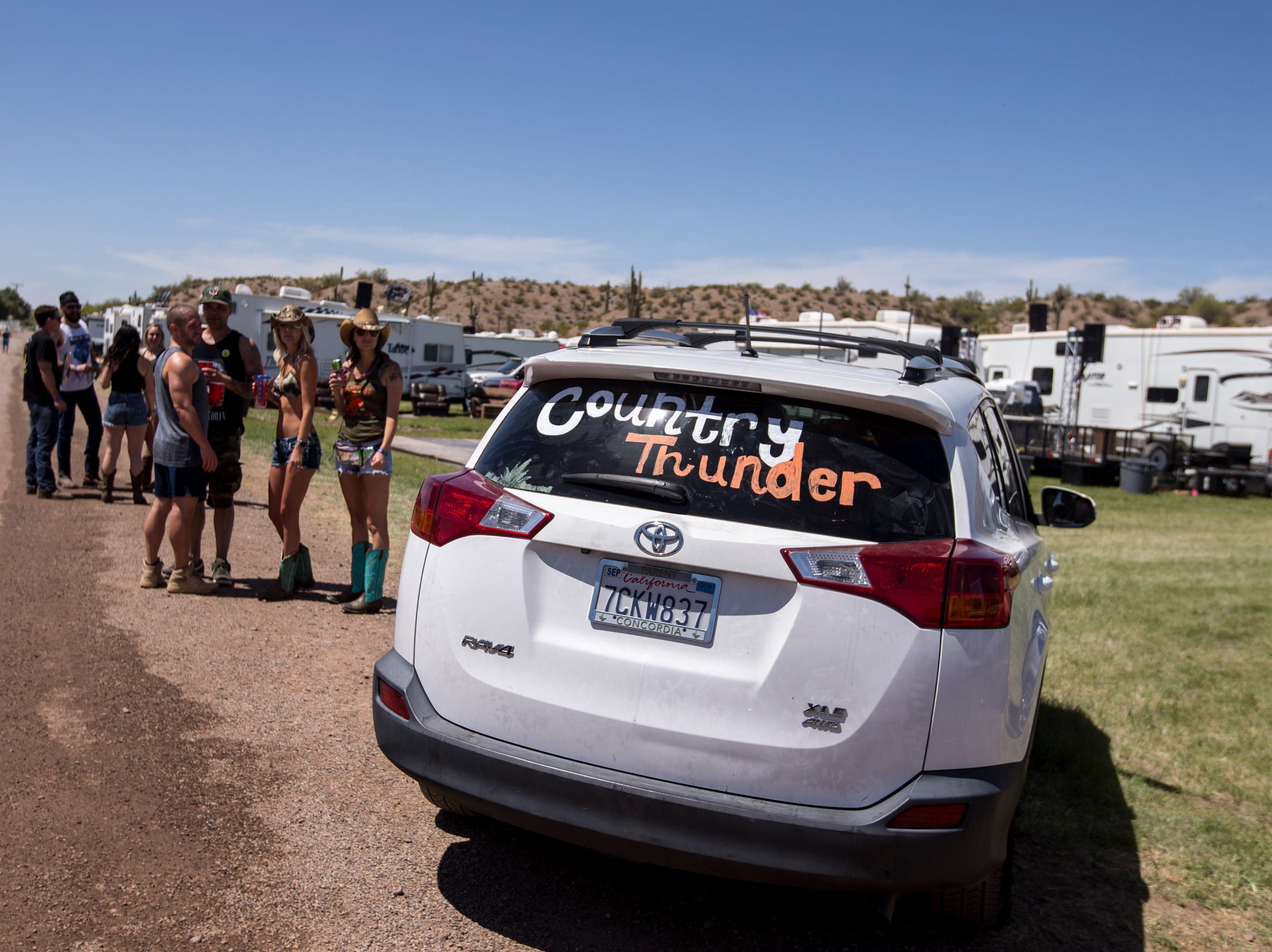 Festival-goers drive into a campsite on April 11, 2019, during Day 1 of Country Thunder Arizona in Florence.