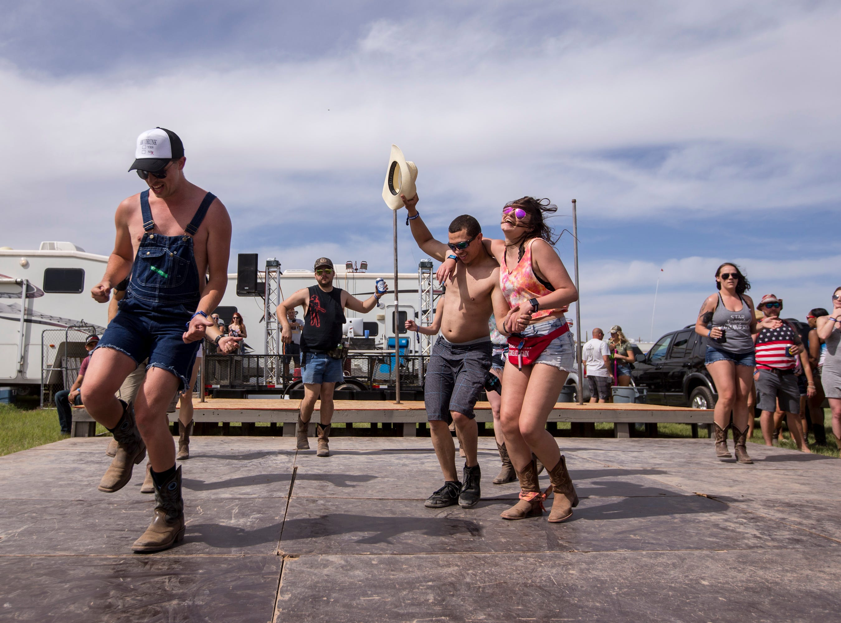 Festival-goers dance at the Crazy Coyote campsite on April 11, 2019, during Day 1 of Country Thunder Arizona in Florence.
