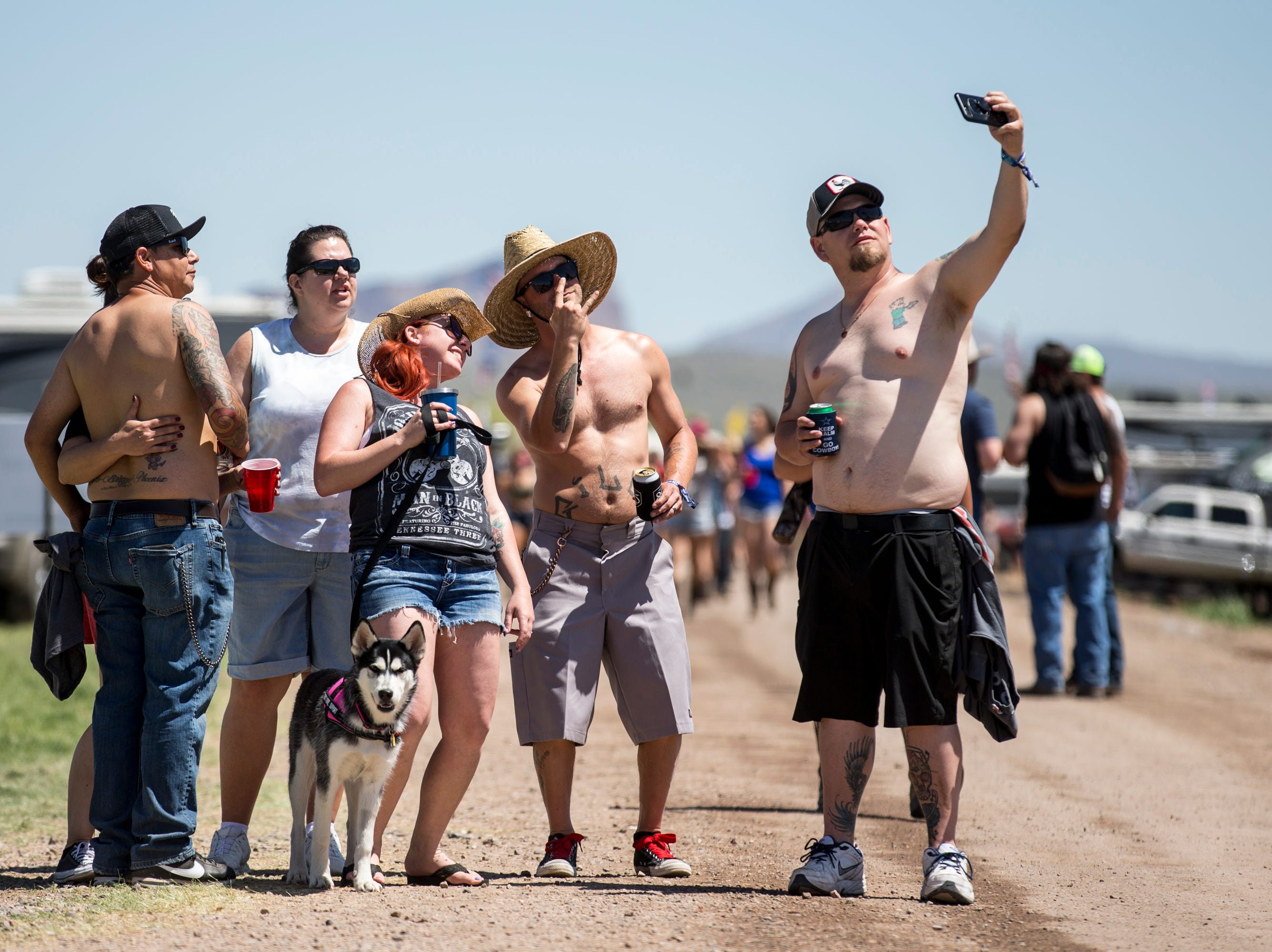 Festival-goers take a selfie on April 11, 2019, during Day 1 of Country Thunder Arizona in Florence.