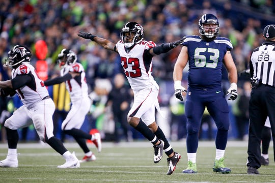 Falcons cornerback Robert Alford (23) and celebrates after a missed field goal by the Seahawks during a game on Nov. 20, 2017.