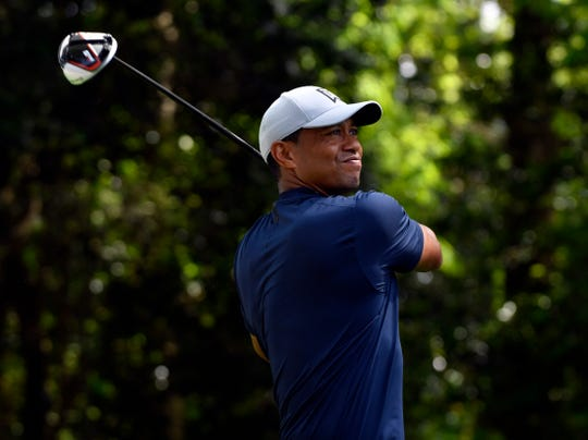 Tiger Woods hits his tee shot on the second hole April 11 during the first round of The Masters golf tournament at Augusta National Golf Club.