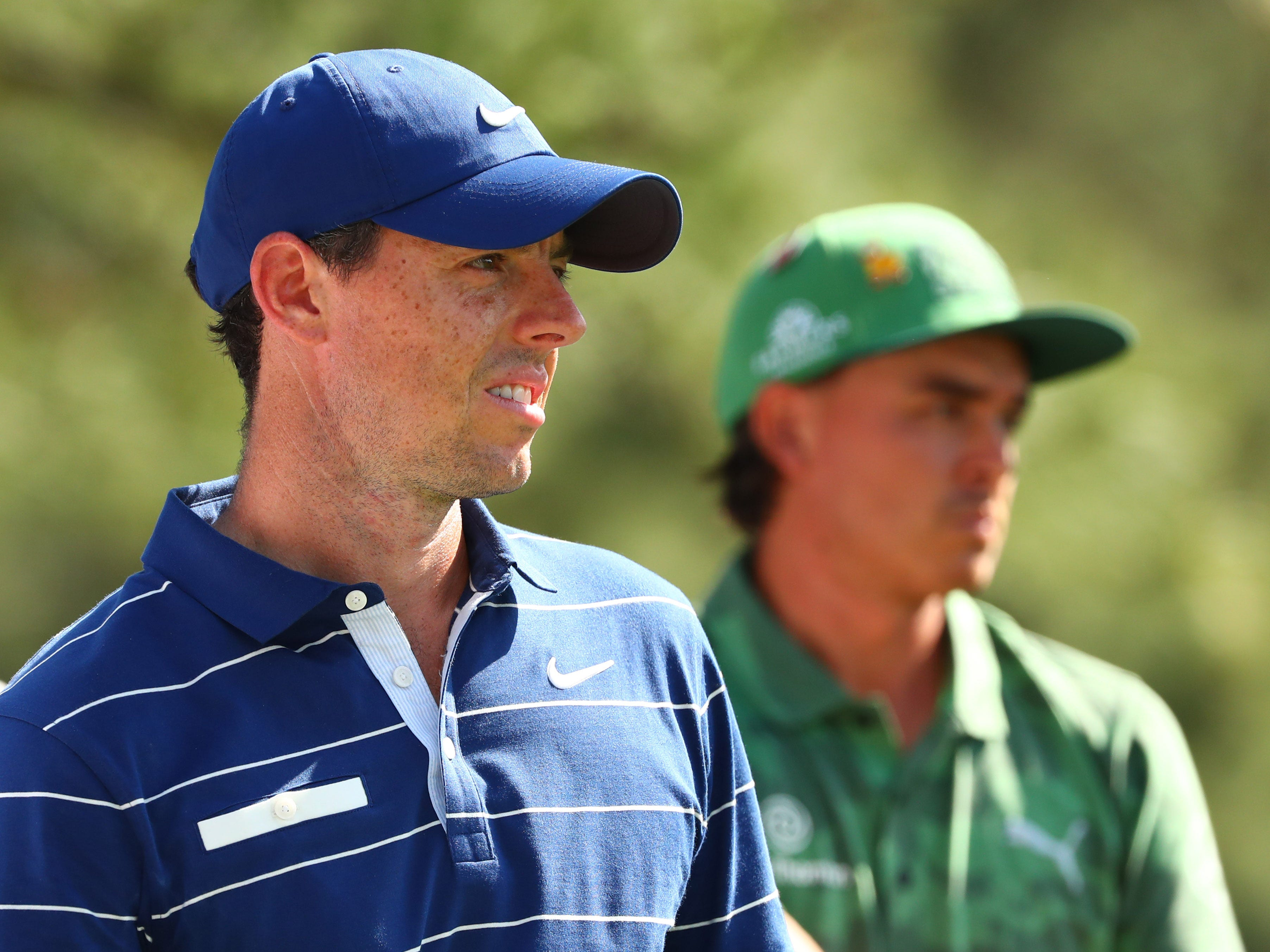 Apr 11, 2019; Augusta, GA, USA; Rory McIlroy (left) and Rickie Fowler on the 18th tee during the first round of The Masters golf tournament at Augusta National Golf Club.