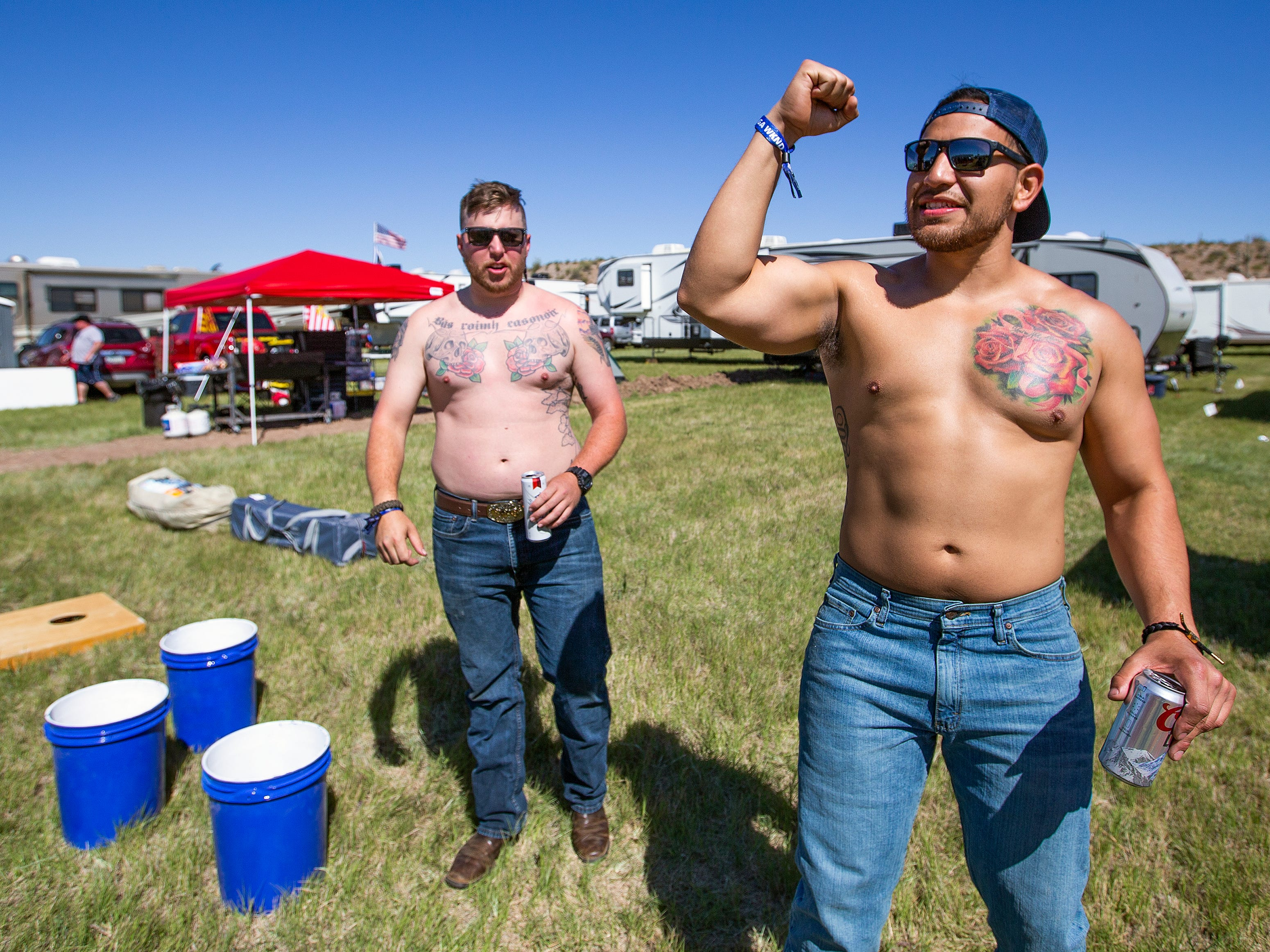 Kyle Billingsley (left), 28, and  Jose Munoz, 28, both from Phoenix, play bucket pong in their camp at the Country Thunder Arizona 2019 music festival April 11, 2019.
