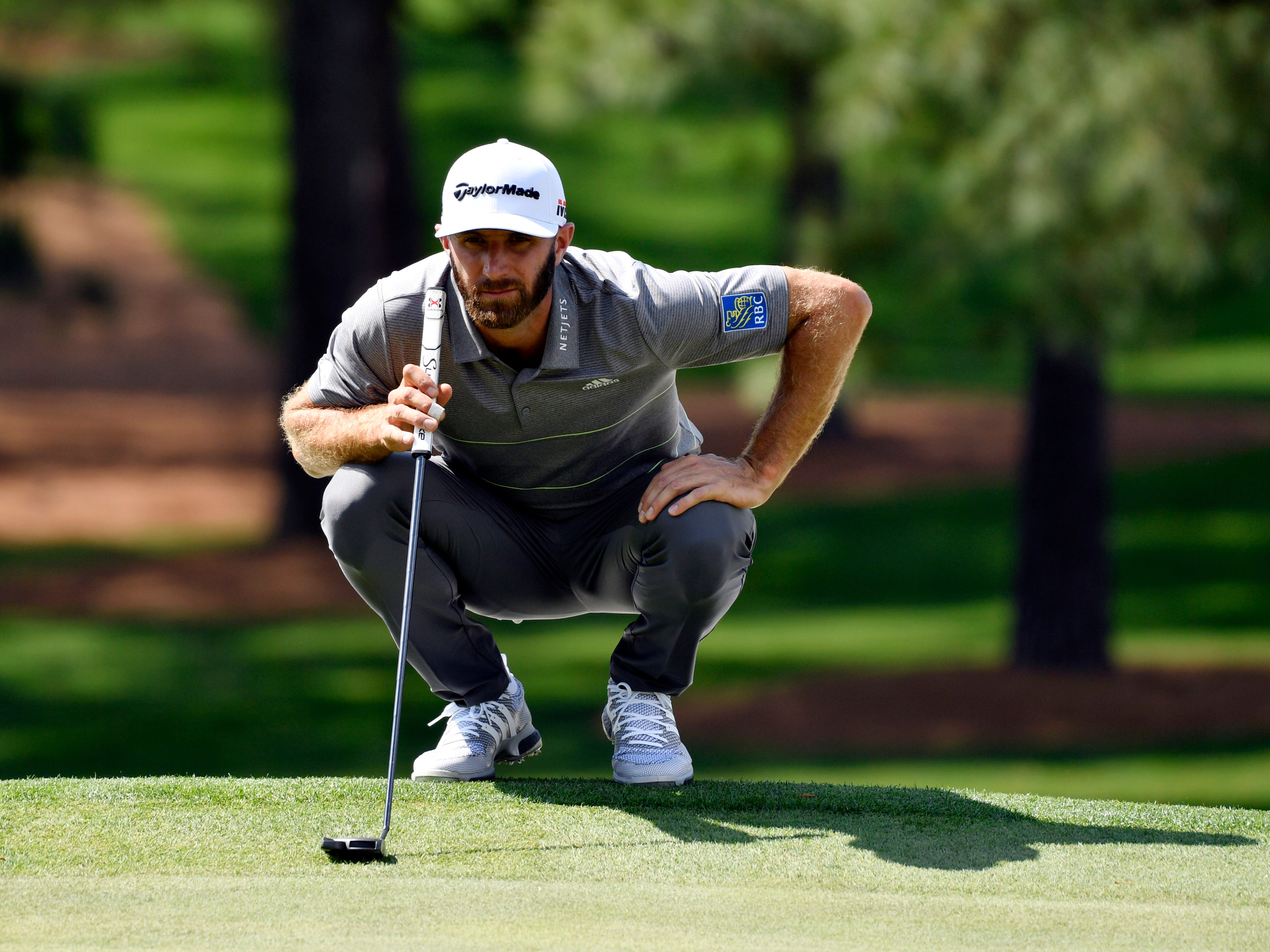 Apr 11, 2019; Augusta, GA, USA; Dustin Johnson lines up a putt on the 7th green during the first round of The Masters golf tournament at Augusta National Golf Club.