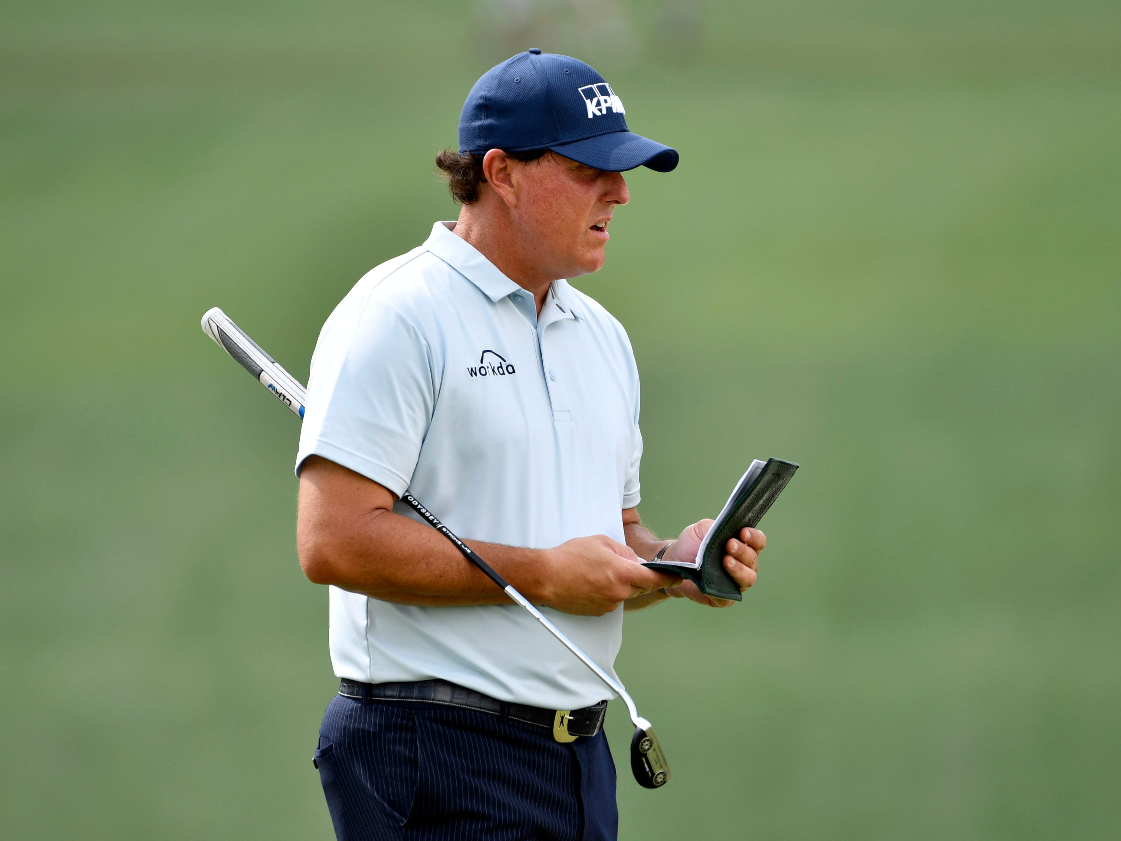 Apr 11, 2019; Augusta, GA, USA; Phil Mickelson checks his yardage book on the 7th green during the first round of The Masters golf tournament at Augusta National Golf Club.