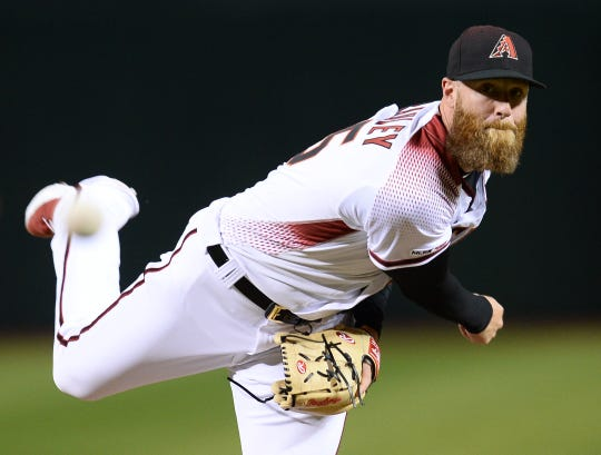 Apr 10, 2019; Phoenix, AZ, USA; Arizona Diamondbacks relief pitcher Archie Bradley (25) pitches against the Texas Rangers during the seventh inning at Chase Field. Mandatory Credit: Joe Camporeale-USA TODAY Sports