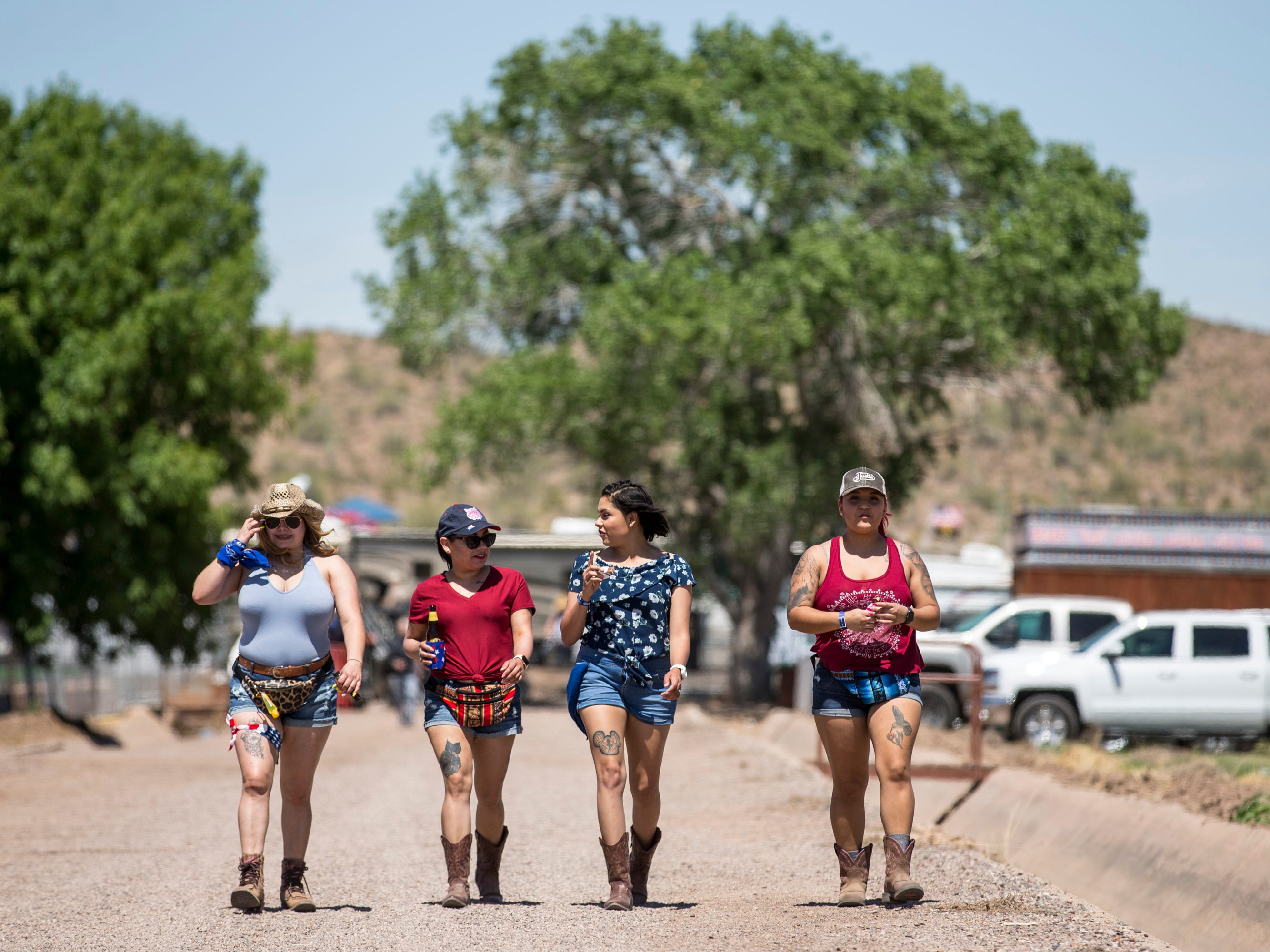 Brianda Arvayo (from left), Angela Perez, Marcela Avalos and Maria Borquez walk around April 11, 2019, during Day 1 of Country Thunder Arizona in Florence.