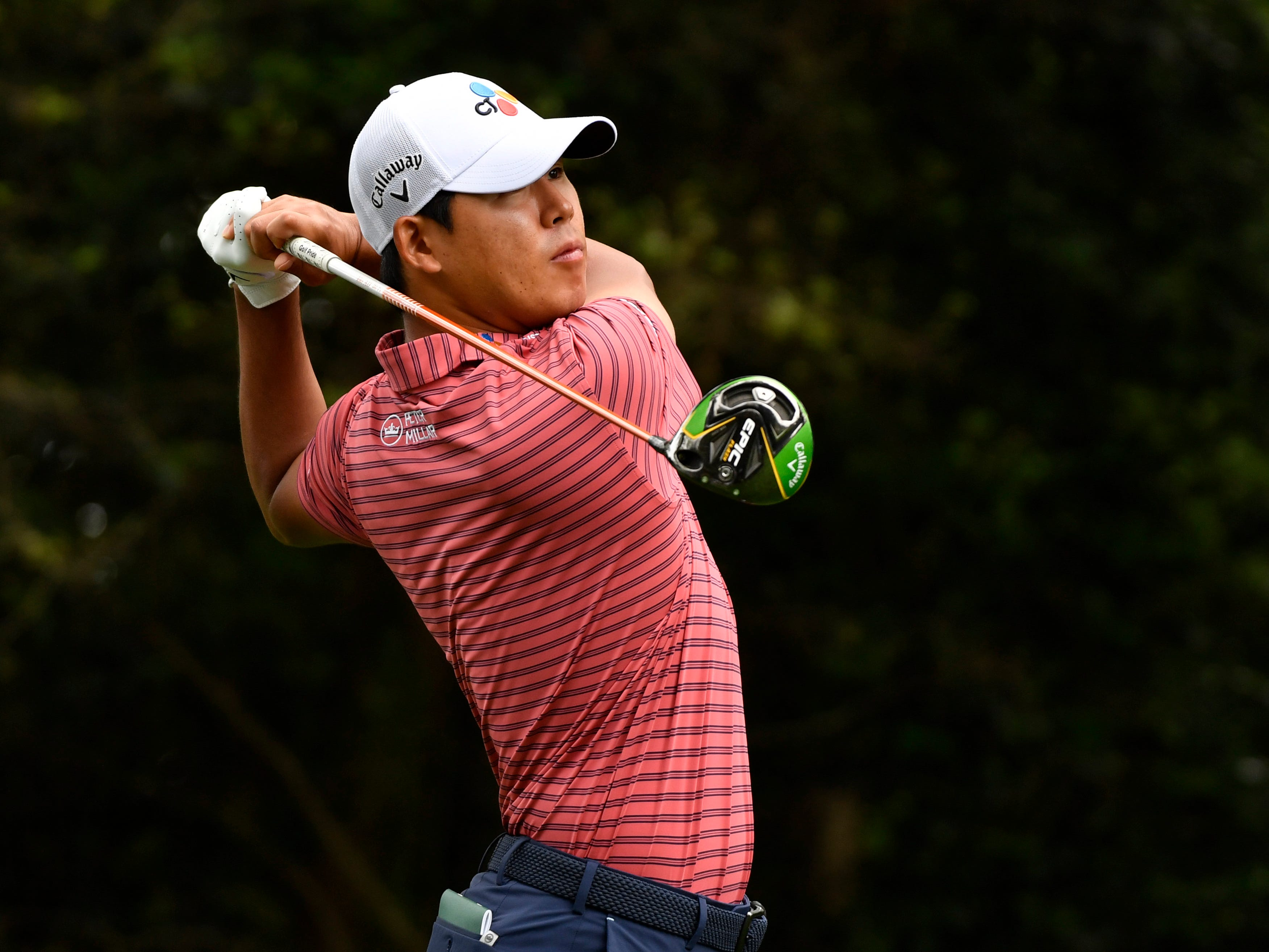 Apr 11, 2019; Augusta, GA, USA; Si Woo Kim hits his tee shot on the 2nd hole during the first round of The Masters golf tournament at Augusta National Golf Club.