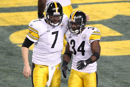 Ben Roethlisberger (7) congratulates running back Rashard Mendenhall (34) after Mendenhall's touchdown during Super Bowl XLV against the Green Bay Packers at Cowboys Stadium. Green Bay defeated Pittsburgh, 31-25.